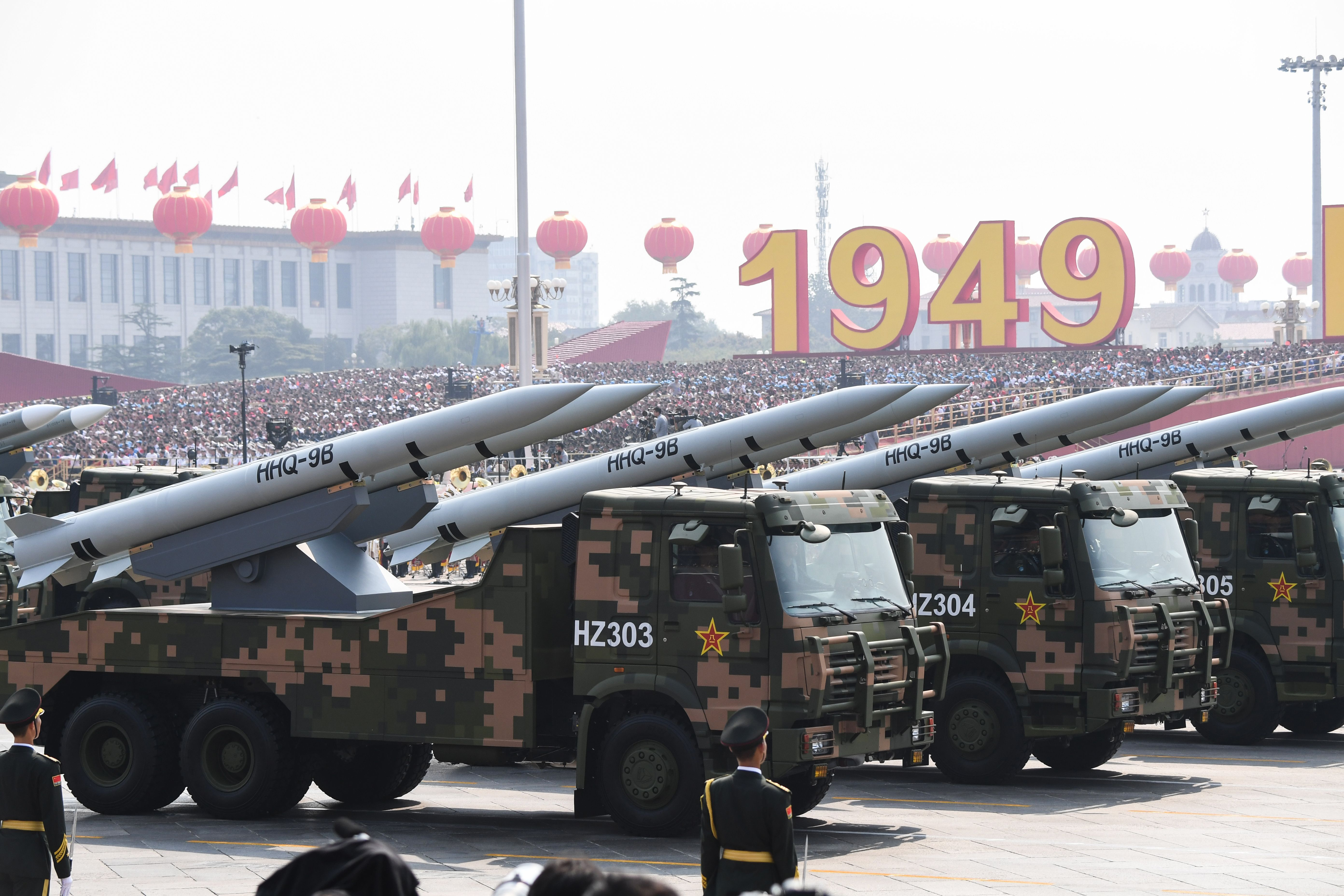 Military vehicles carry HHQ-9B surface-to-air missiles through Tiananmen Square. (Greg Baker/AFP via Getty Images)
