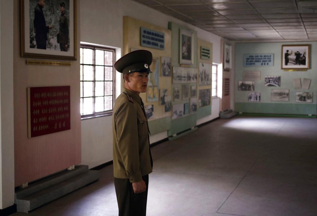 North Korean Army Lt. Colonel Hwang Myong Jin stands inside the museum of the armistice agreement between North and South Korea at the truce village at the Demilitarized Zone (DMZ) which separates the two Koreas in Panmunjom, North Korea, Wednesday, June 20, 2018. Hwang, who has been a guide on the northern side of the Demilitarized Zone that divides the two Koreas for five years, says that since the summits between North Korean leader Kim Jong Un and the presidents of South Korea and the United States, things have quieted down noticeably in perhaps the most iconic symbol of the one last place on Earth where the Cold War still burns hot. (Dita Alangkara/AP)