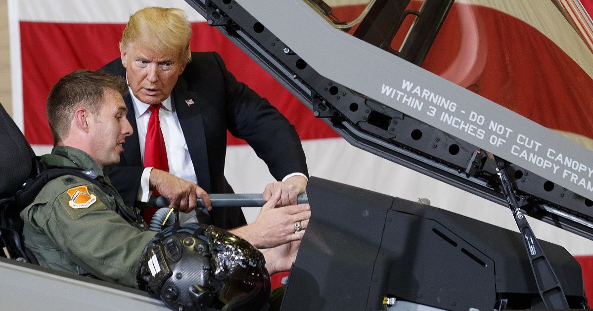 President Donald Trump talks to a pilot in the cockpit of an F-35 aircraft during a Defense Capability Tour at Luke Air Force Base, Ariz., Friday, Oct. 19, 2018. (AP Photo/Carolyn Kaster)