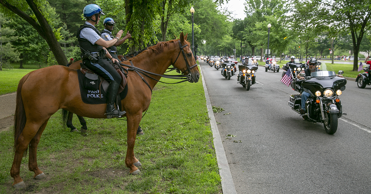 Park Police officers wave to riders as they pass them during Rolling Thunder XXXI First Amendment Demonstration Run along Independence Ave. in Washington, DC on Sunday May 27, 2018. Motorcycle riders from across the nation, rode a designated route through the Mall area of Washington, D.C. The event is an actual demonstration/protest to bring awareness and accountability for POWs and MIAs left behind.(Alan Lessig/Staff)
