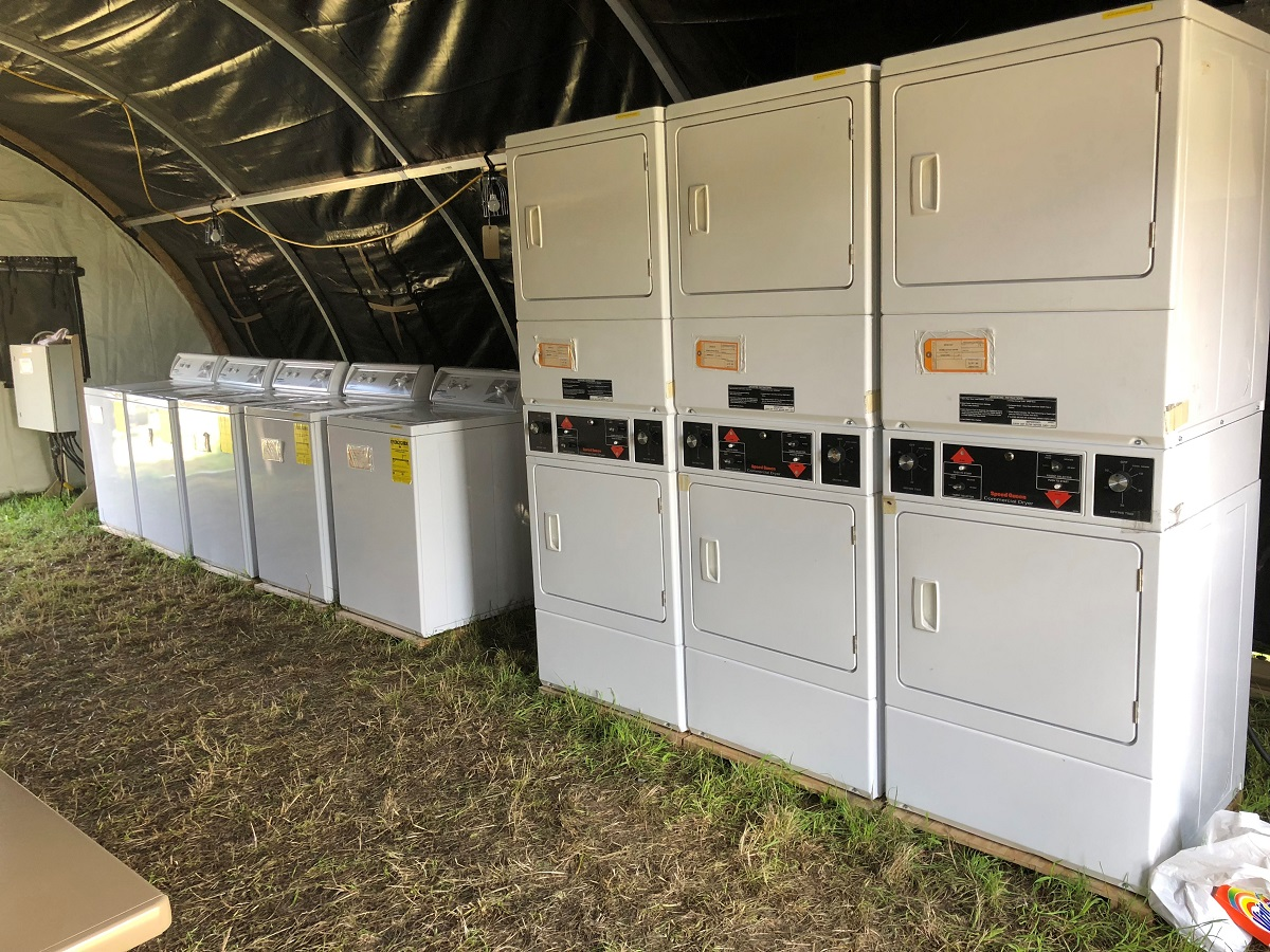 Over the course of the exercise, 87 trucks, two C-130J aircraft and a train moved the equivalent of 321 pallets of equipment into Krzesiny, Poland, by July 31. These washing machines were among that sent via C-130 to the 31st Air Base. (Valerie Insinna/Staff)