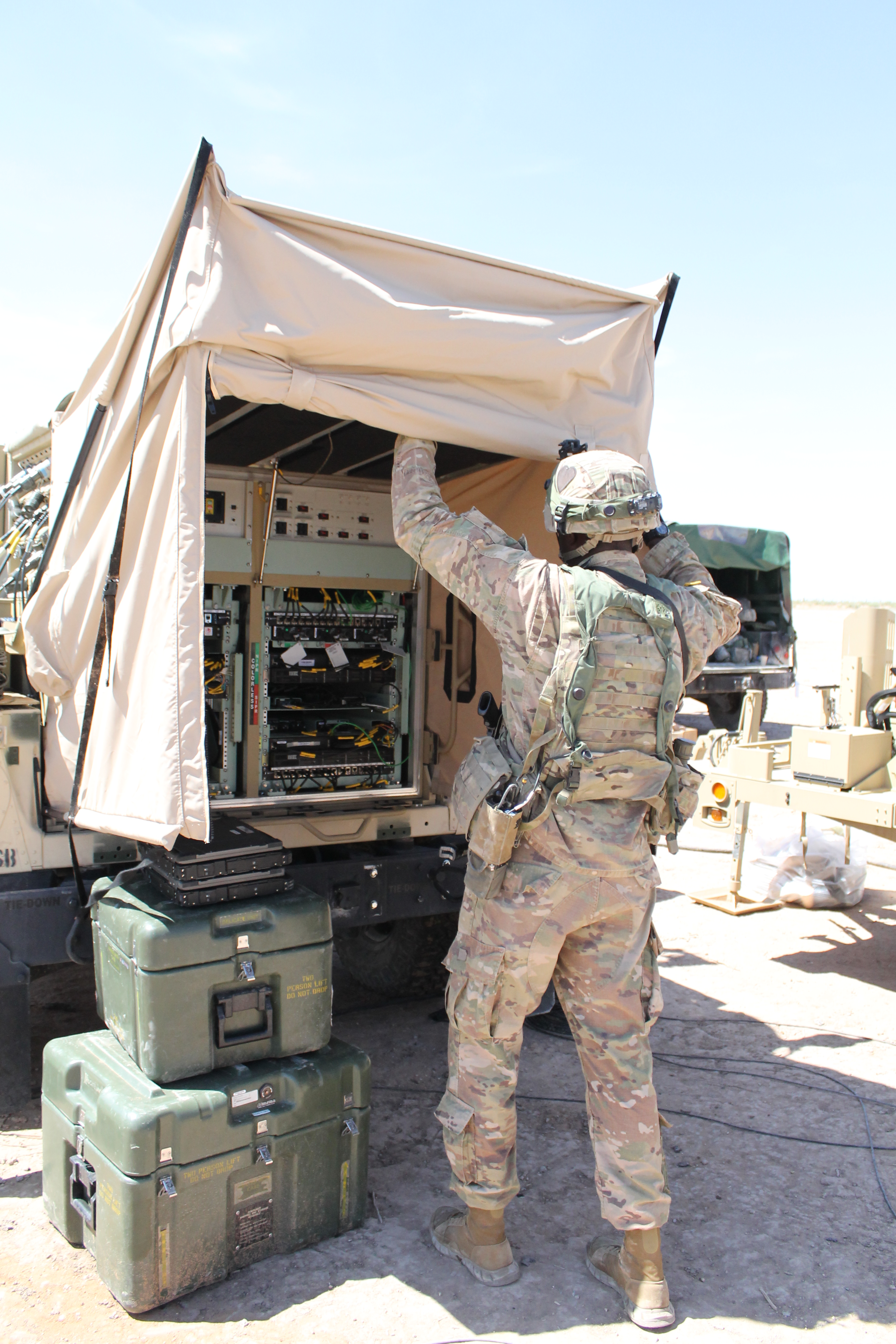 A soldier operates the Tactical Communications Node-Lite (TCN-L) at the NIE just outside of the TOC. The TCN-L was delivered by sling-load. TCN-L is essentially a smaller, more nimble node of the Warfighter Information Network-Tactical, the Army's tactical network. Previously, WIN-T was so large it a 5-ton truck was used as the platform. It required a ladder to access the equipment. (Jen Judson/Staff)