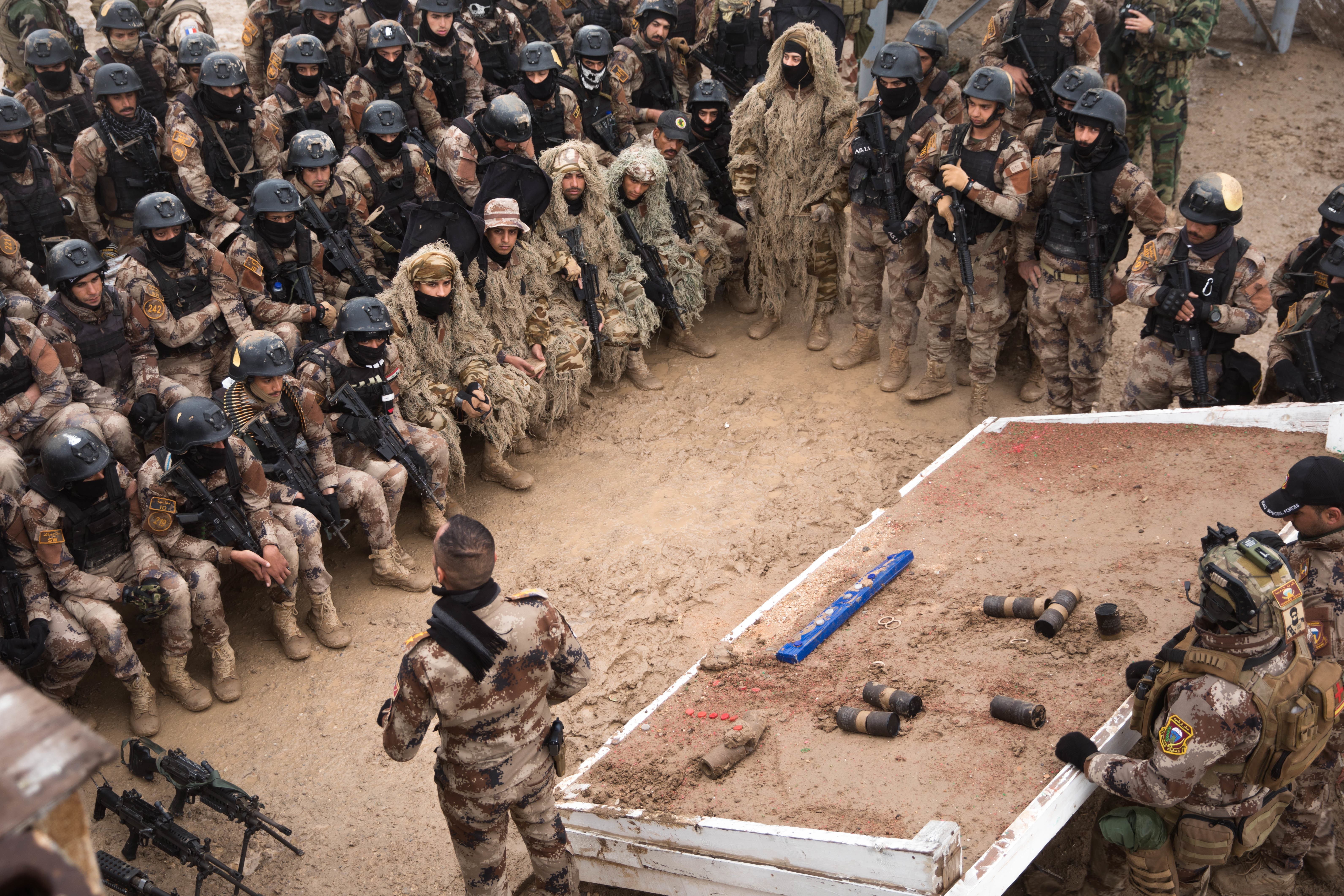 The Iraqi Counter-Terrorism Service's students are briefed before completing the last portion of the integration phase at a range complex in Besmaya, Iraq. (Spc. Sarah K. Anwar/Army)