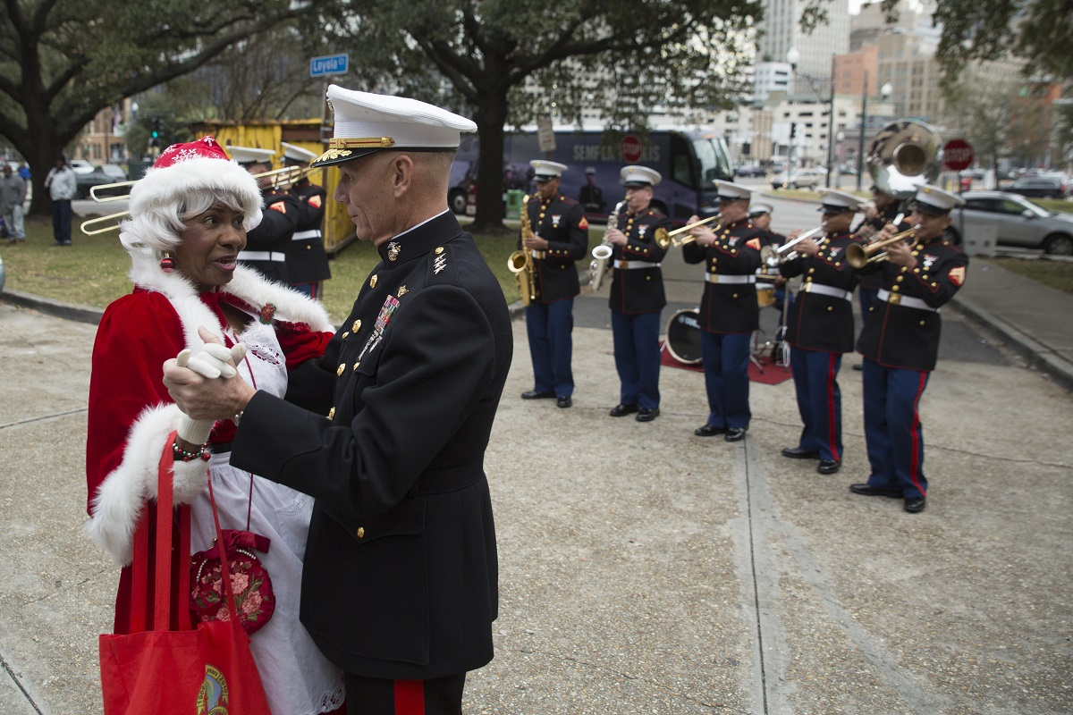 Lt. Gen. Rex C. McMillian, commander of Marine Forces Reserve and Marine Forces North, dances with Mrs. Claus during the Krewe of Zulu Toys for Tots toys distribution event at the New Orleans city hall, Dec. 16,2017. (Sgt. Ian Ferro/Marine Corps)
