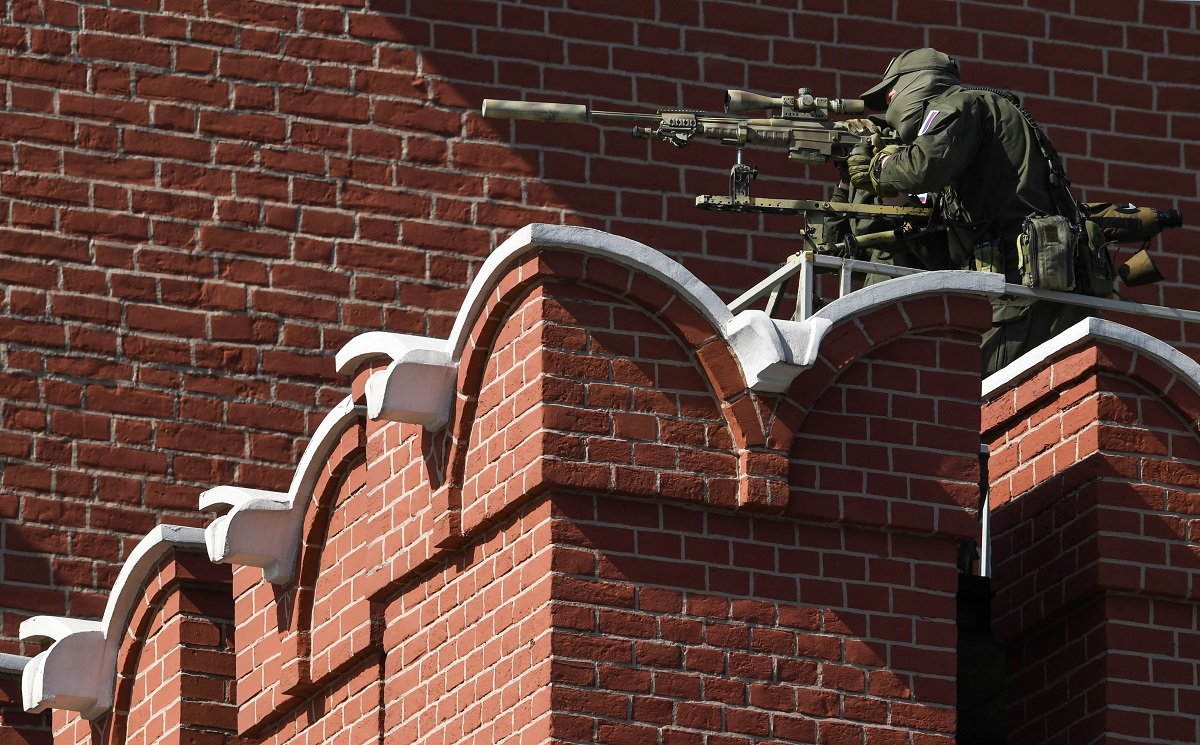 A Russian sniper secures the area prior to the Victory Day military parade at Red Square in Moscow on May 9, 2018. (Kirill Kudryavtsev/AFP via Getty Images)
