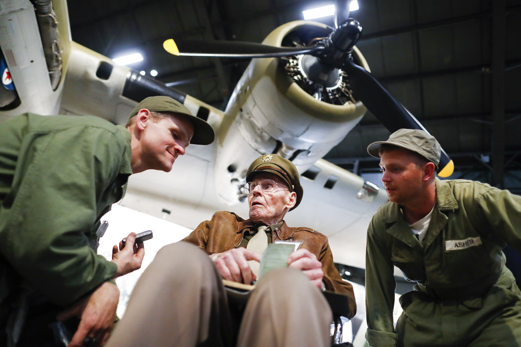 United States Air Force (Ret.) Col. Howard Hunt, center, meets with Memphis Belle fans during the private viewing of the Boeing B-17