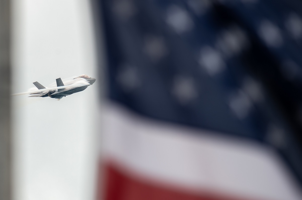 "Capt. Andrew ""Dojo"" Olson, F-35 Heritage Flight Team commander and pilot, performs aerial maneuvers in an F-35A Lightning II during the Chicago Air and Water Show in Chicago, Ill., on Aug. 18, 2018. (Airman 1st Class Alexander Cook/U.S. Air Force)"