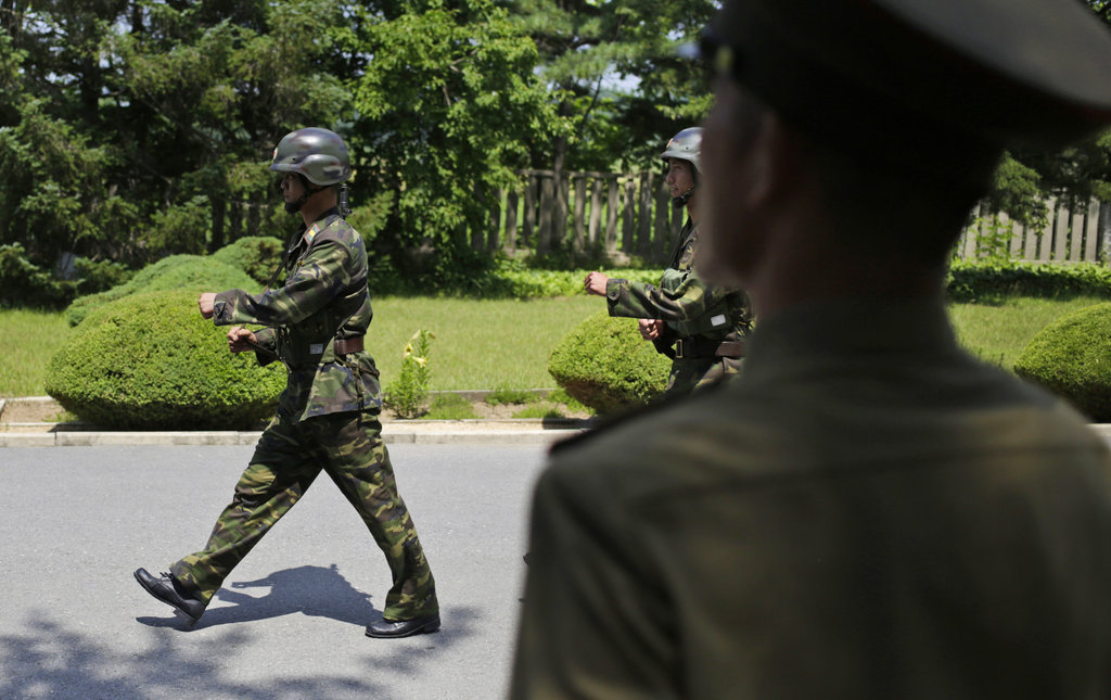 North Korean soldiers stand guard at the truce village of Panmunjom at the Demilitarized Zone (DMZ) which separates the two Koreas in Panmunjom, North Korea, Wednesday, June 20, 2018. (Dita Alangkara/AP)