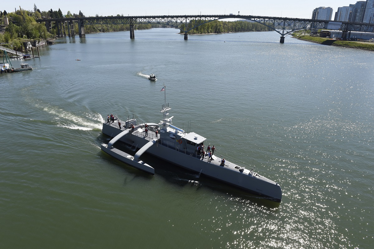 The unmanned submarine-hunting surface drone Sea Hunter gets underway on the Williammette River in Portland, Ore. The platform represents an enormous technological leap for unmanned maritime systems. (John Williams/U.S. Navy)