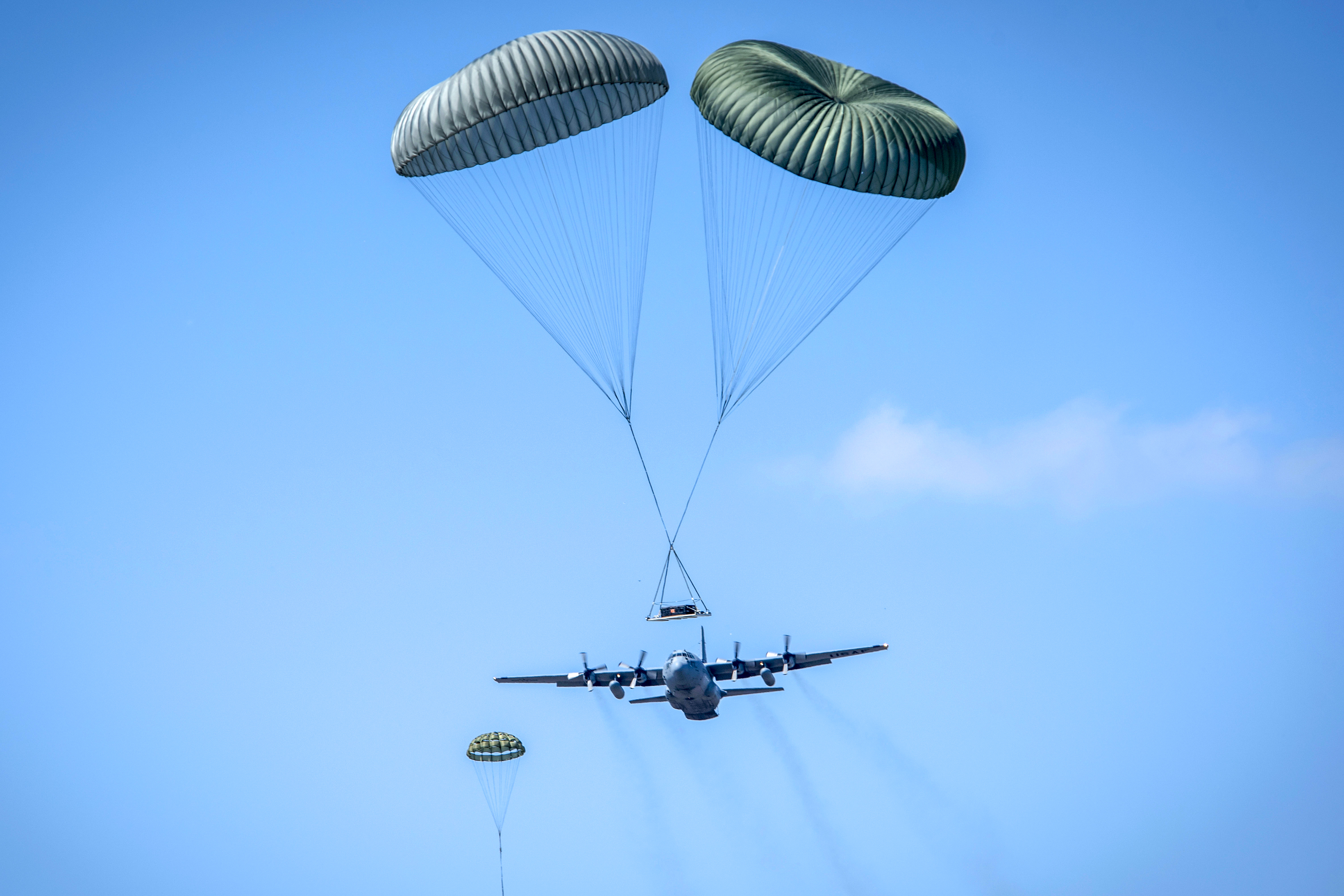 The 179th Airlift Wing conducts a five ship formation flight using five of their eight C-130H Hercules to conduct coordinated airdrops. (Tech. Sgt. Joe Harwood/Air Force)