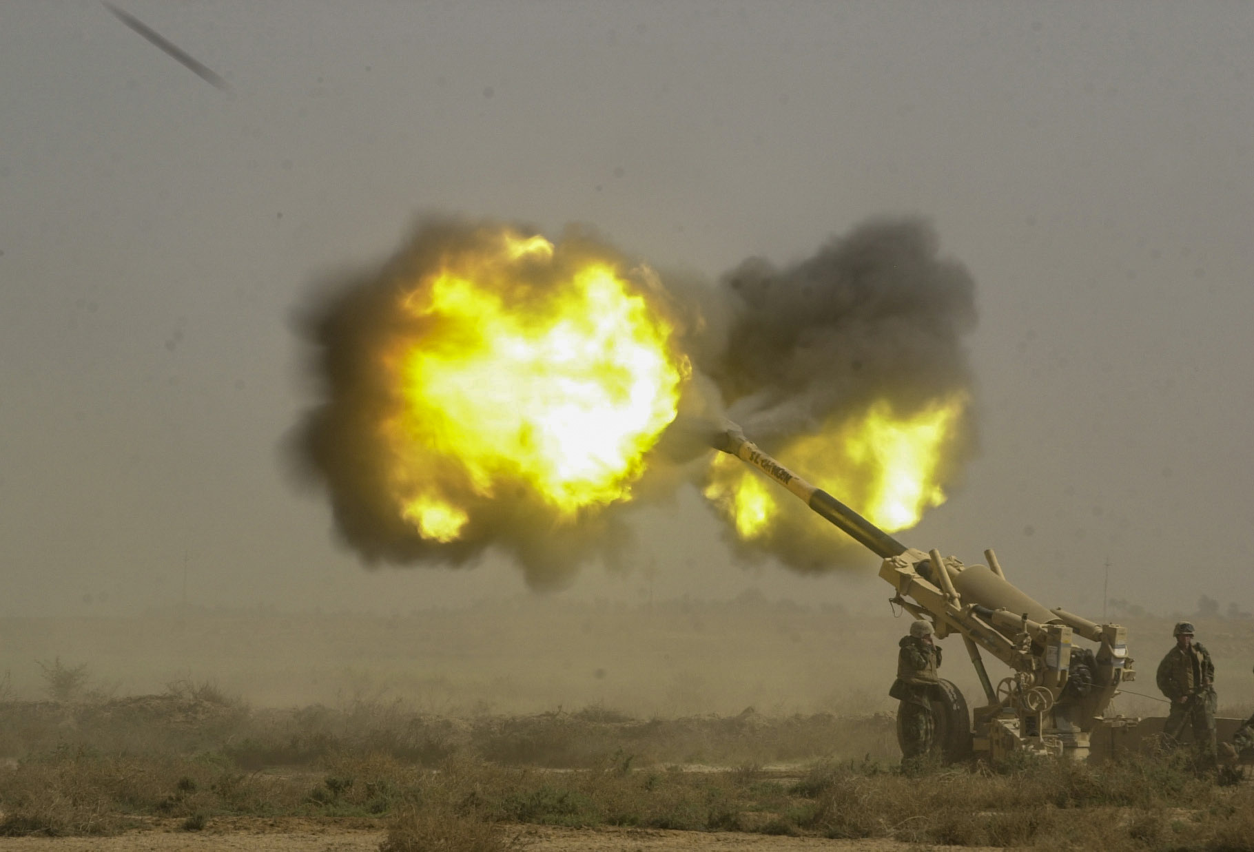 Marines from Battery M, 3rd Battalion, 11th Marine Regiment fire a 155mm Howitzer towards Iraqi military positions in Al Kut, Iraq . ( Jud McCrehin/Marine Corps Times)