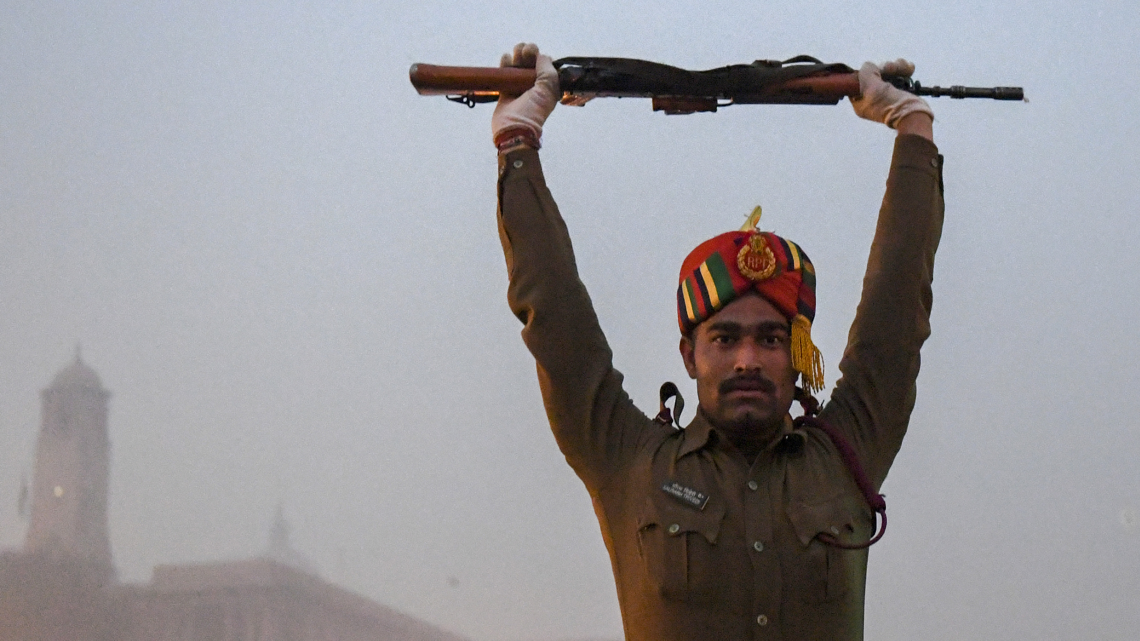 A member of the Indian Central Reserve Police Force (CRPF) warms up during the rehearsal for the upcoming Republic Day parade in New Delhi on January 2, 2019. - India will celebrate its 70th Republic Day on January 26. (MONEY SHARMA/AFP/Getty Images)