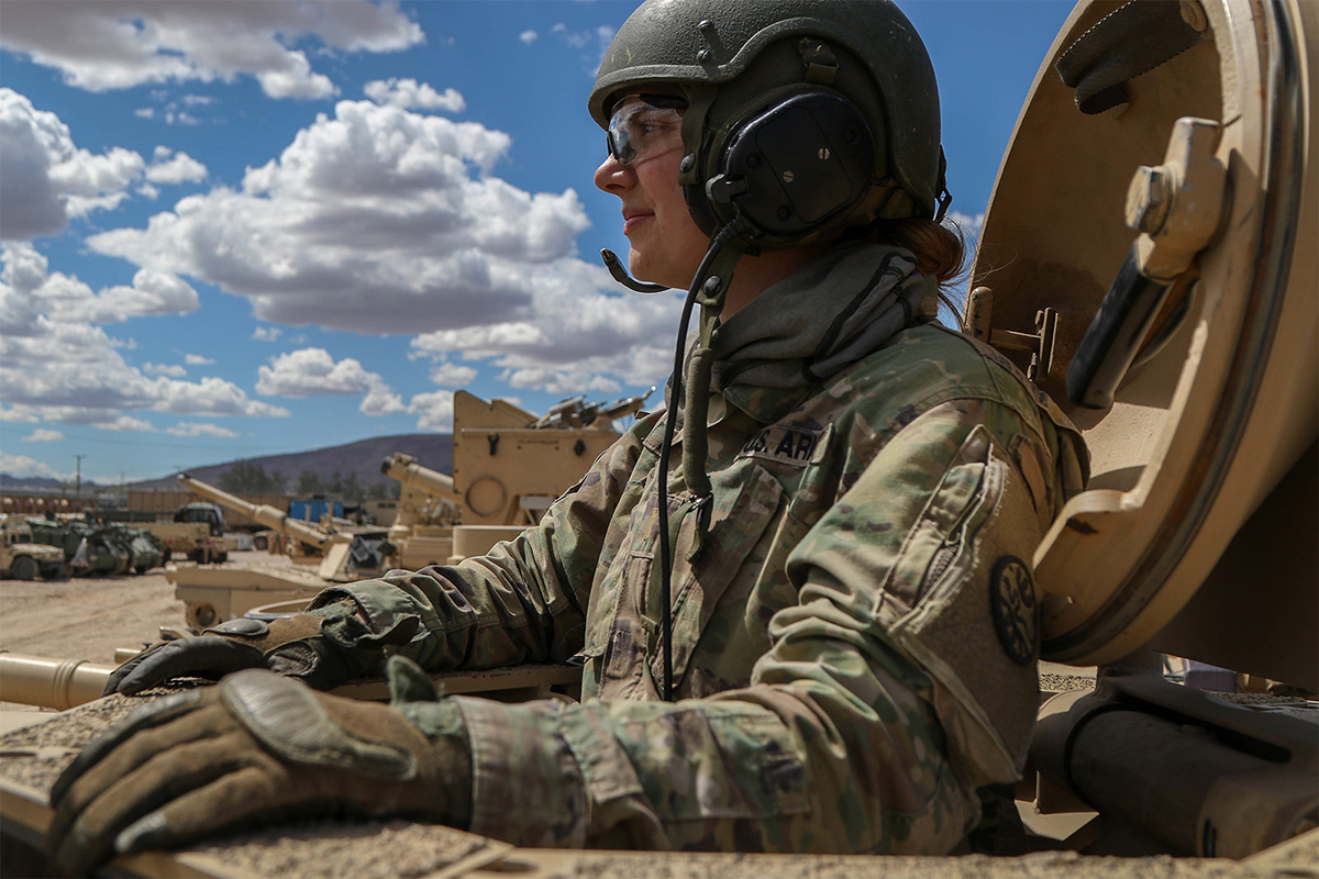 Army 2nd Lt. Caitlyn Simpson prepares her platoon for a training mission from inside a tank at Fort Irwin, Calif., May 28. 2019. (Cpl. Alisha Grezlik/Army)