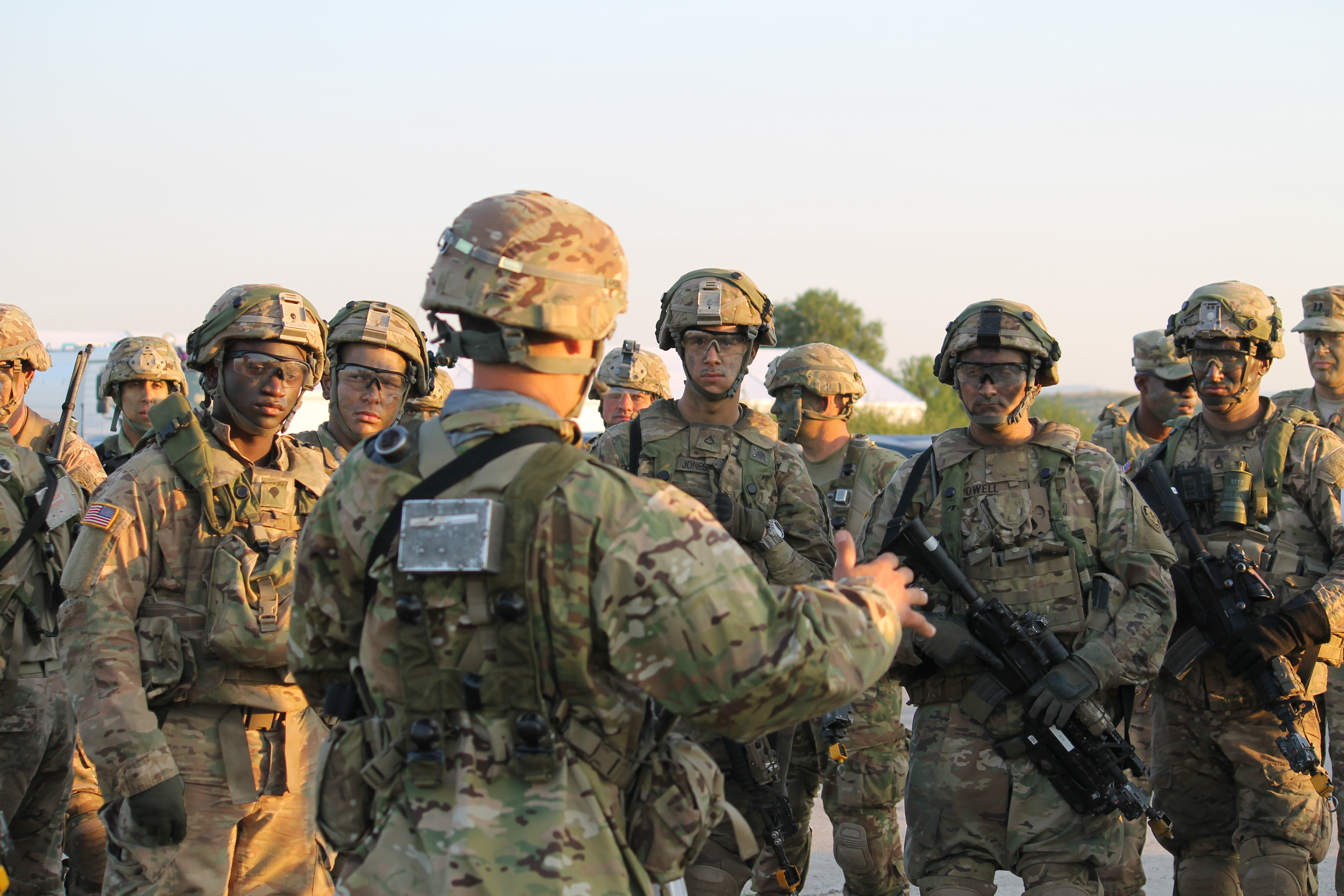 Troops in the U.S. Stryker unit discuss the mission ahead once on the ground. (Jen Judson/Staff)