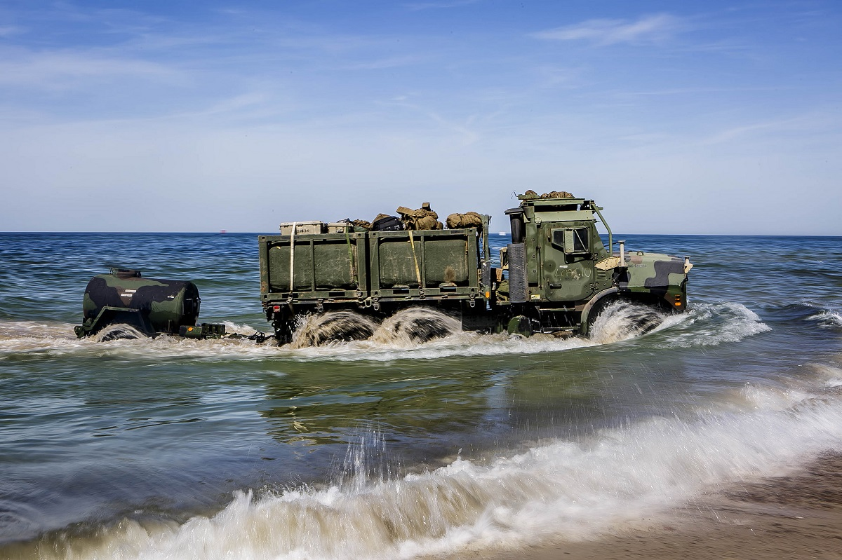 Try to keep dry! A U.S. Marine Corps Medium Tactical Vehicle Replacement attached to Combat Logistics Battalion 26, 26th Marine Expeditionary Unit drives on shore during exercise BALTOPS 2018 at Ustka, Poland, on June 7. (Dengrier M. Baez/U.S. Marine Corps)