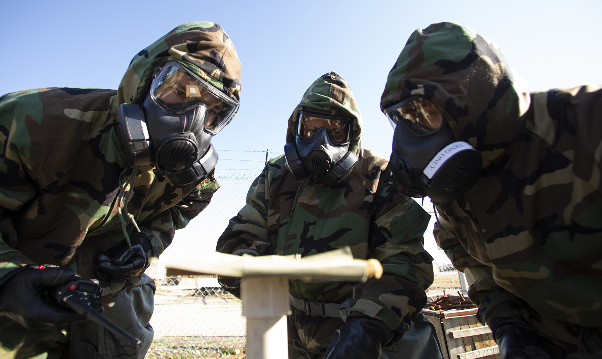 U.S. airmen with the 163d Attack Wing, California Air National Guard evaluate a reaction found on chemical detection paper during training on Jan. 11, 2020, at March Air Reserve Base, Calif. (Staff Sgt. Crystal Housman/Air National Guard)