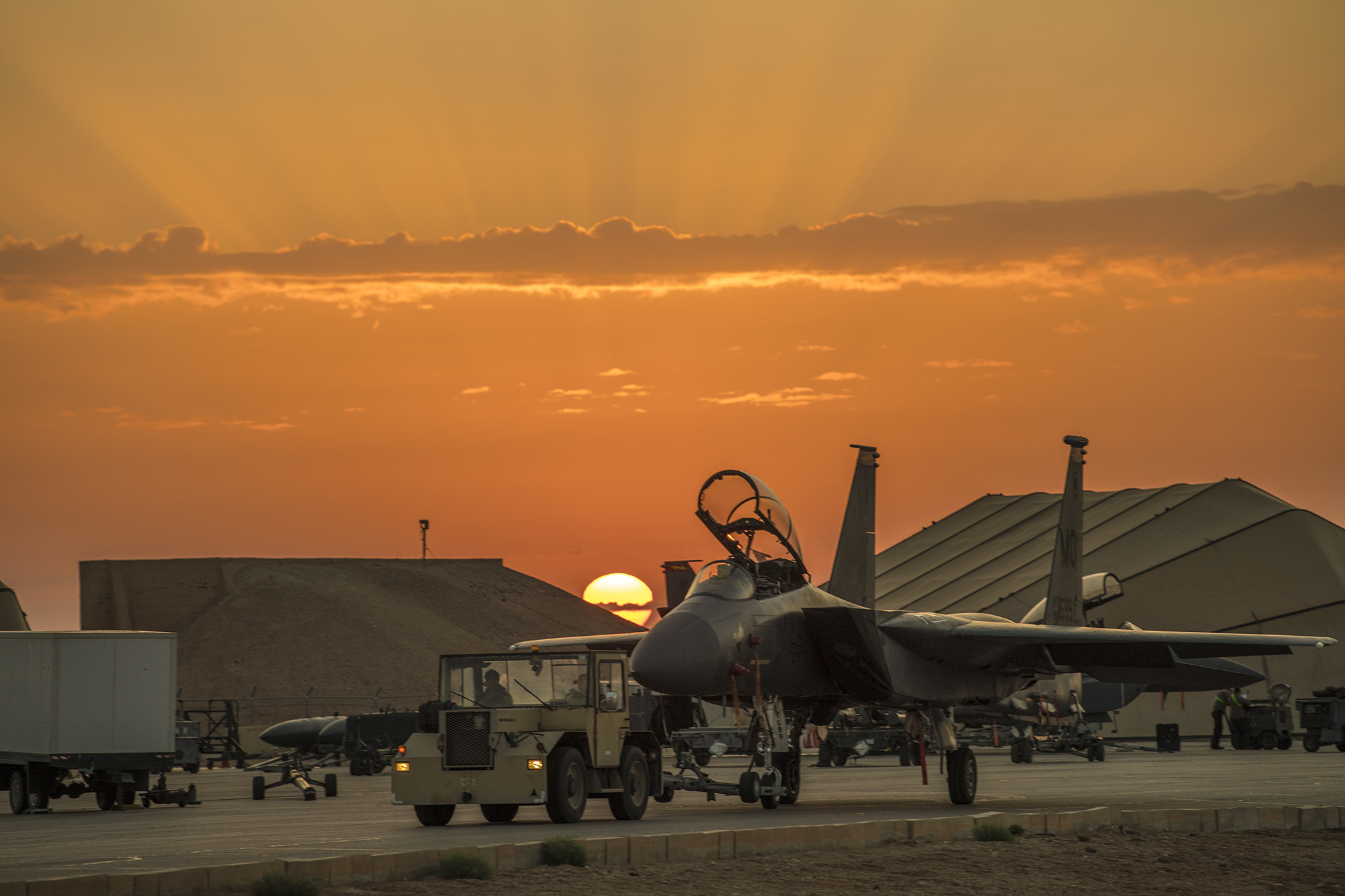 Airmen assigned to the 332nd Air Expeditionary Wing tow an F-15E Strike Eagle on April 15, 2020, at an undisclosed location in Southwest Asia. (Senior Master Sgt. Ralph Branson/Air Force)