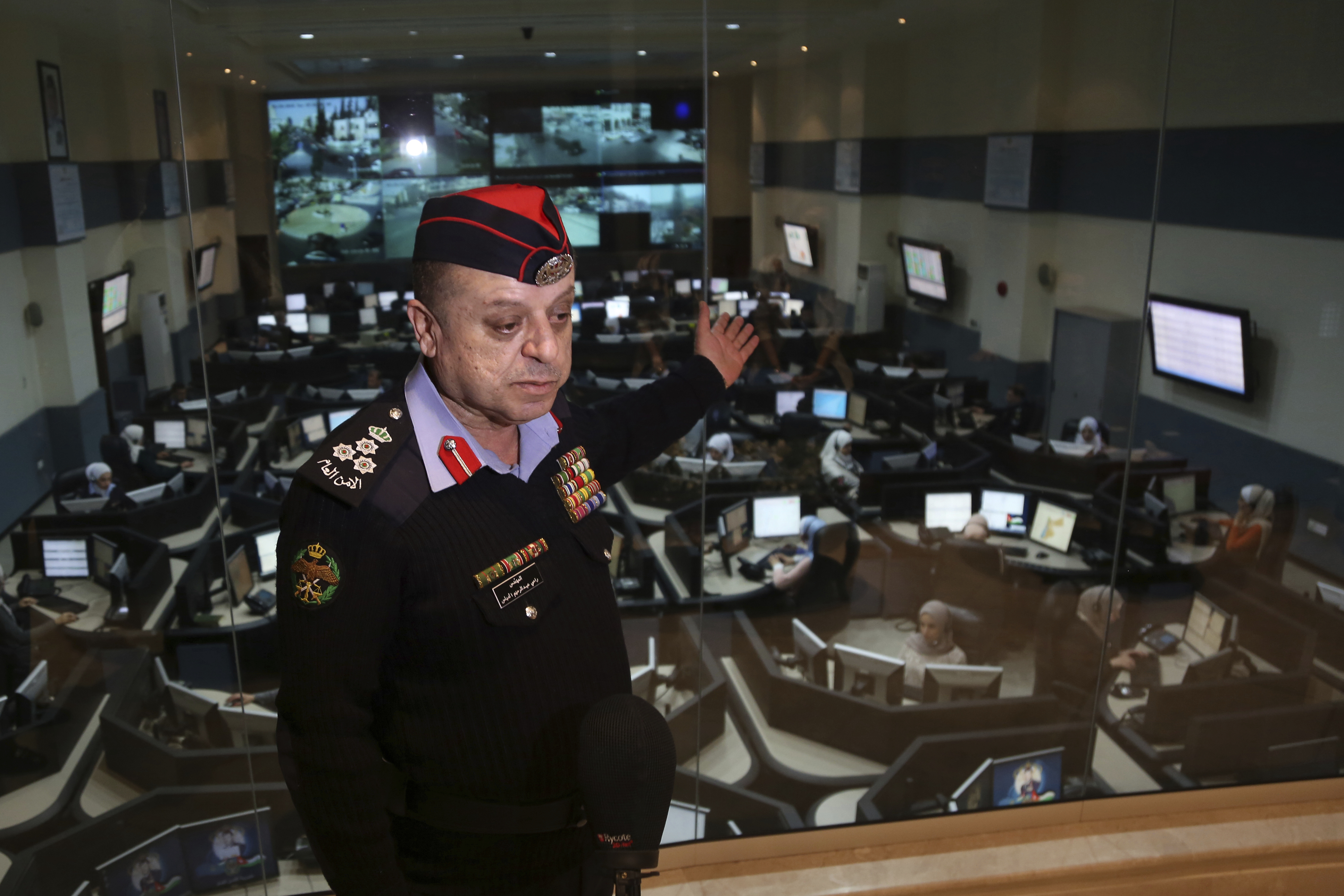 Brig. Rami al-Dabbas, the head of Jordan's Command and Control Center, explains the operations of the national 911 emergency call center, which receives thousands of calls a day, in Amman, Jordan. (Raad Adayleh/AP)
