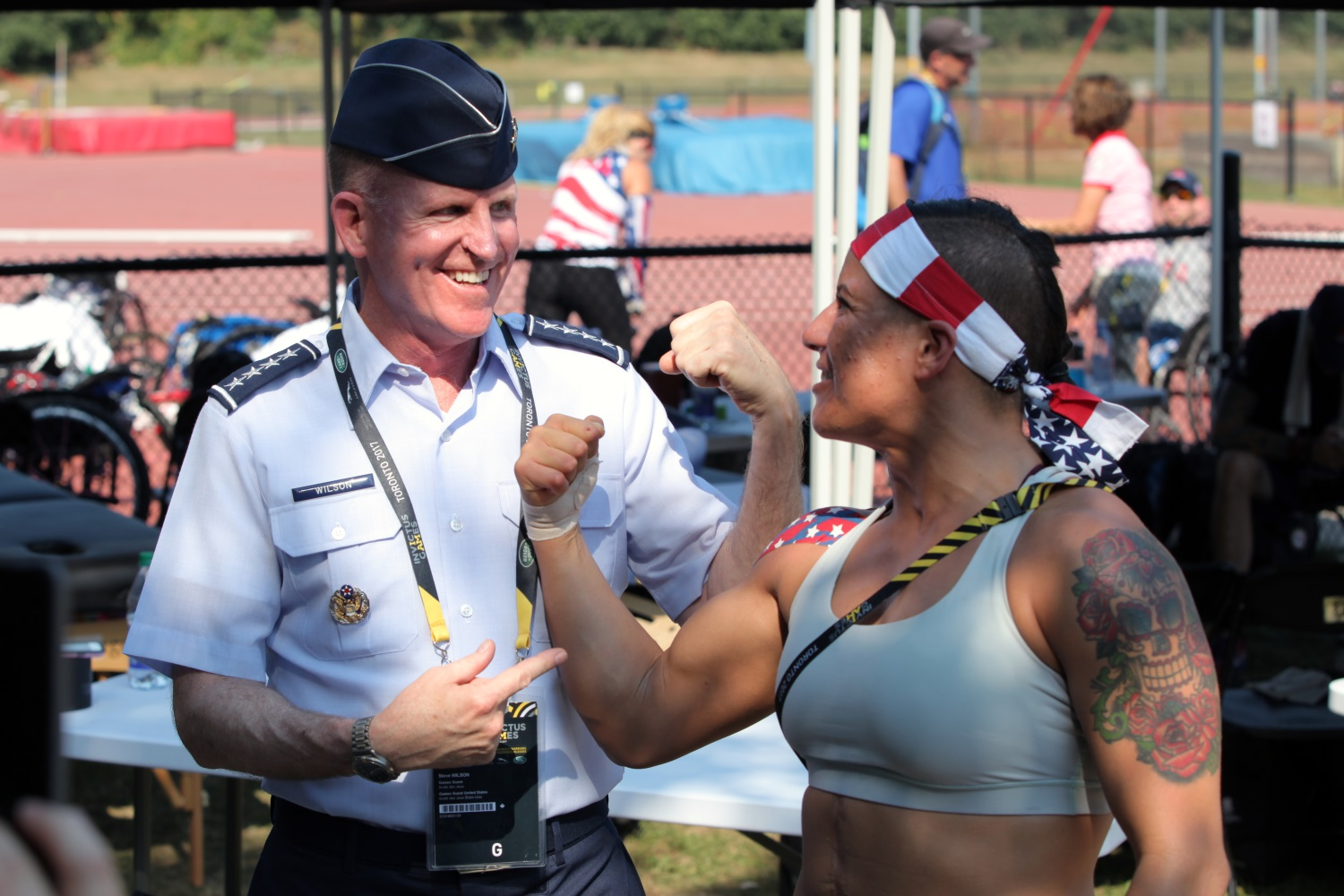 Vice Chief of Staff of the Air Force Gen. Stephen W. Wilson talks with Staff. Sgt. Sebastiana Lopez-Arellano at York Lions Stadium in Toronto, Canada, on Sept. 24, 2017. The Invictus Games, Sept. 23-30, is an international, Paralympic-style, multi-sport event, created by Prince Harry of Wales, in which wounded, injured or sick armed services personnel and their associated veterans take part in sports including wheelchair basketball, wheelchair rugby, sitting volleyball, archery, cycling, wheelchair tennis, powerlifting, golf, swimming and indoor rowing. (Staff Sgt. Daniel Luksan/Army)