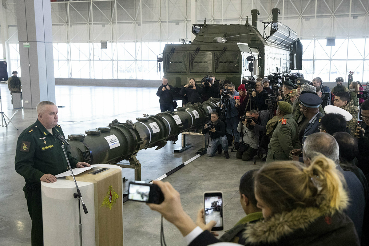 Lt. Gen. Mikhail Matveevsky, the chief of the military's missile and artillery forces, left, speaks during a briefing by the Russian Defense Ministry, as the 9M729 land-based cruise missile, center, is displayed near its launcher, right, in Kubinka outside Moscow on Jan. 23, 2019. (Pavel Golovkin/AP)