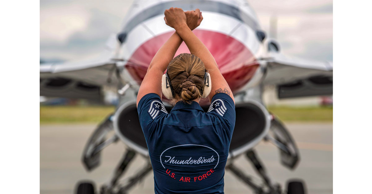 Air Force Staff Sgt. Kaitlyn Lamolinara, Air Force Thunderbird dedicated crew chief, signals to Air Force Maj. Matt Kimmel, Air Force Thunderbird opposing solo,who arrives in preparation for the Air Force Thunderbirds demo during the Arctic Thunder Open House on Joint Base Elmendorf-Richardson, Alaska, June 27, 2018. (A1C Caitlin Russell/Air Force)