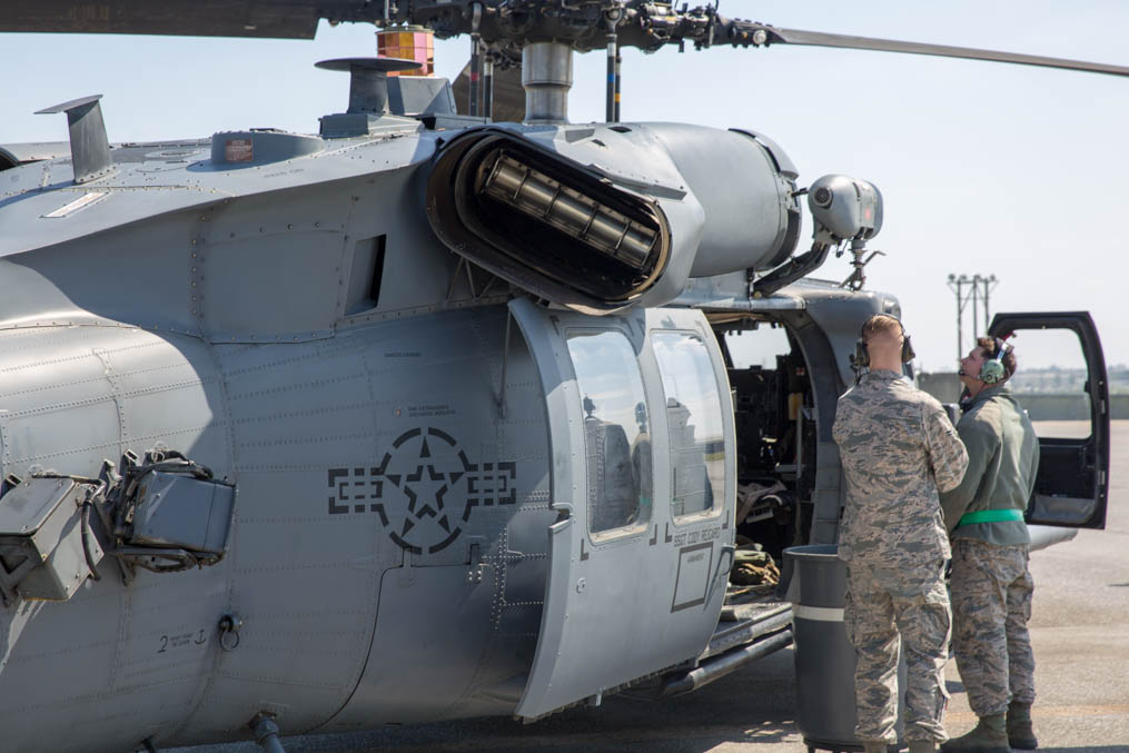 Two maintainers inspect an HH-60G of the 33rd Rescue Squadron on Kadena Air Base. (Jeff Martin/Staff)