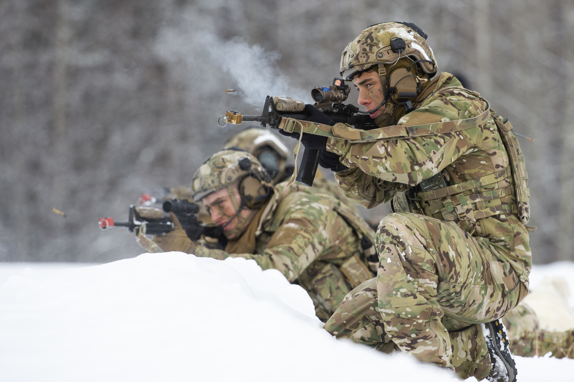 Airman 1st Class Nathan Ortiz, right, and fellow tactical air control party apprentices engage simulated opposing forces while conducting small-unit training at Joint Base Elmendorf-Richardson, Alaska, Feb. 12, 2020. (Alejandro Peña/Air Force)