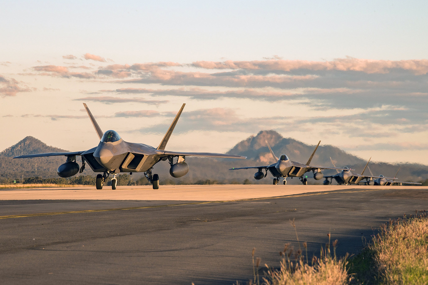 F-22 Raptors taxi to their parking location at the Royal Australian Air Force Base Amberley flightline for Talisman Sabre 19 on July 9. (Staff Sgt. Kyle Johnson/Air Force)