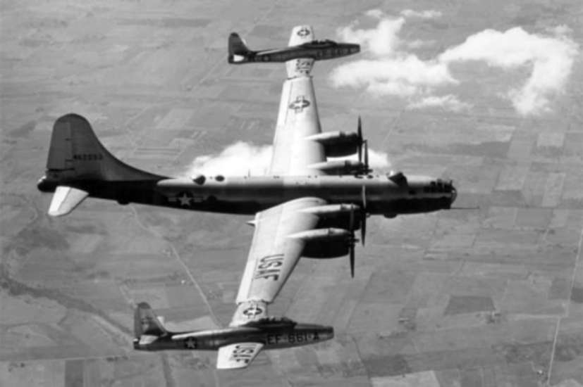 A Boeing ETB-29A is coupled with two Republic EF-84D Thunderjet fighters during an experimental flight for Project Tip-Tow on Oct. 20, 1950. (U.S. Air Force)
