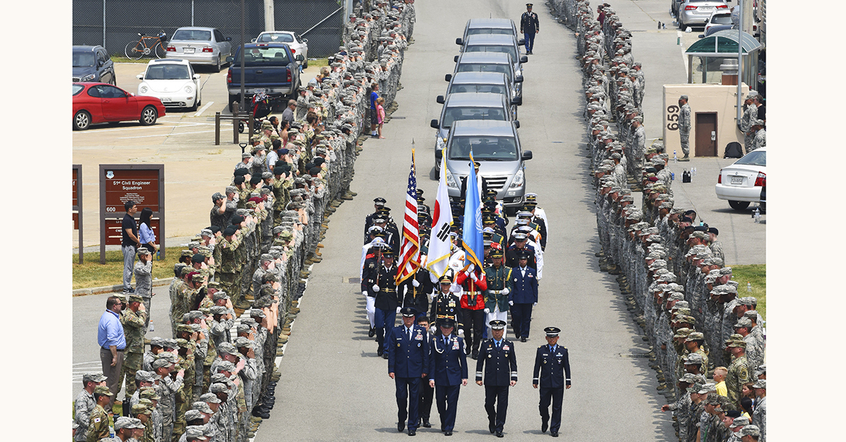 An honor guard leads 55 cases of remains of service members repatriated from the Democratic People's Republic of Korea to United Nations Command at Osan Air Base in the Republic of Korea, Friday, July 27, 2018. Members of the command and the Osan community were on hand at the arrival ceremony. (Tech. Sgt. Ashley Tyler/Air Force)