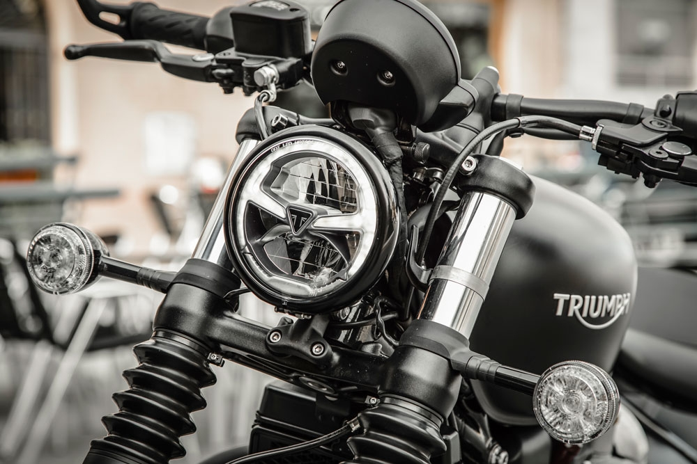 New for the Bobber Black is a daytime running light (the soft white part around the perimeter of the headlight bucket) as well as an LED headlight beam. (Triumph Motorcycles)