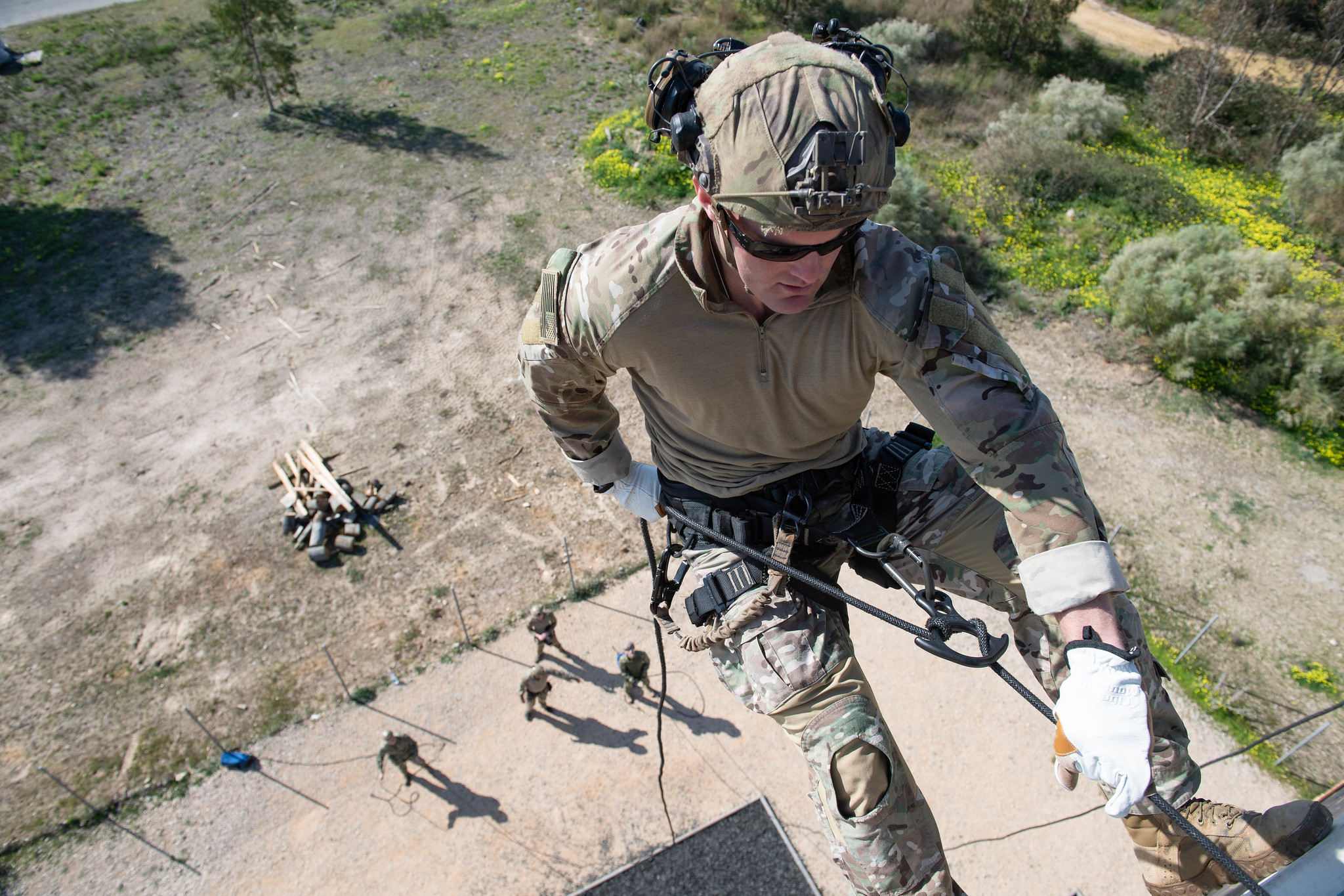 An explosive ordnance technician rappels down a tower at Rota, Spain, as part of helicopter rope suspension technique cast master renewal training and initial training for support personnel on Feb. 20, 2020. (Mass Communication Specialist 3rd Class Katie Cox/Navy)