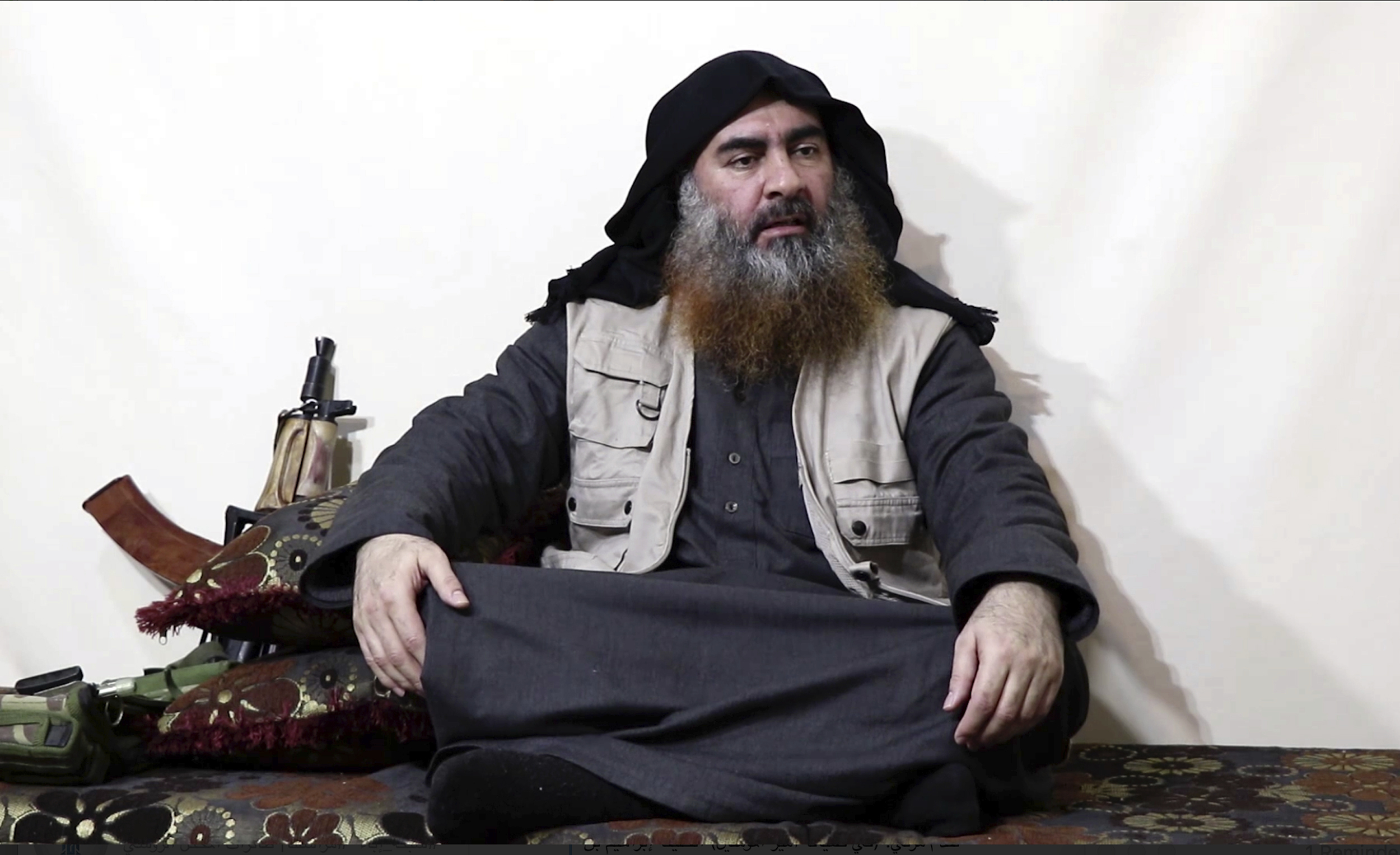 This image made from video posted on a militant website on Monday, April 29, 2019, purports to show the leader of the Islamic State group, Abu Bakr al-Baghdadi, being interviewed by his group's Al-Furqan media outlet. (Al-Furqan media via AP)