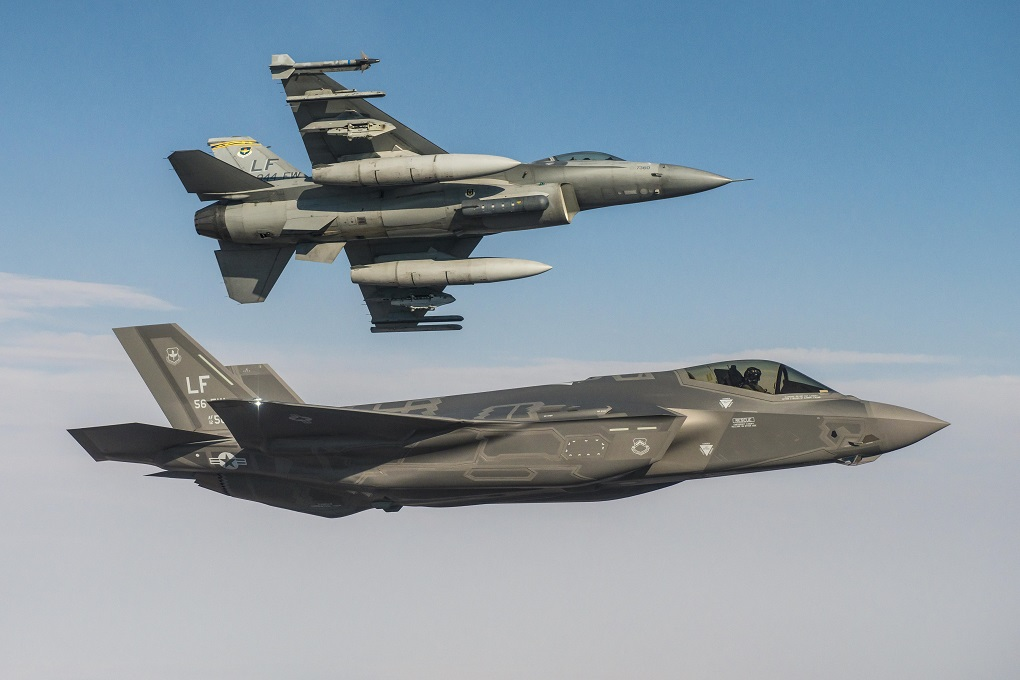 An F-35 Lightning II flies alongside an F-16 Fighting Falcon at Luke Air Force Base, Arizona, in 2015. (Air Force)