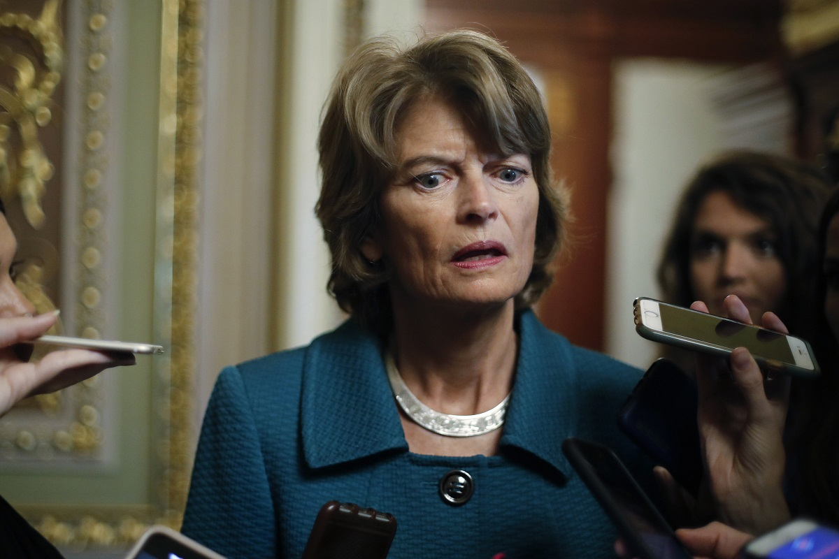 In this Oct. 4, 2018 photo, Sen. Lisa Murkowski, R-Alaska, speaks to members of the media on Capitol Hill in Washington. The fight over President Donald Trump's border wall is heading to the GOP-controlled U.S. Senate, putting Republicans in the uncomfortable spot of deciding whether to back his declaration of a national emergency. (Pablo Martinez Monsivais/AP)