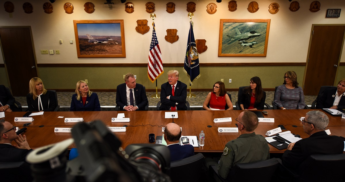 President Donald Trump engages in a roundtable discussion with cabinet members, congressmen and defense industry leaders Friday at Luke Air Force Base, Ariz. The discussion focused on a variety of topics, including cybersecurity, foreign military sales and technological advancement. (Senior Airman Ridge Shan/Air Force)
