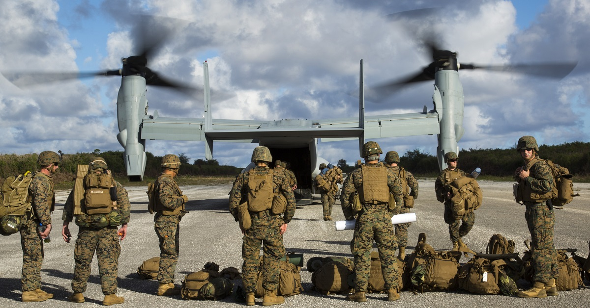 An MV-22B Osprey disembarks Marines Dec. 9 at Baker runway on Tinian's North Field during Exercise Forager Fury II. Marine Aircraft Wing and Marine Aircraft Group exercises and training on Guam and within the Mariana Island Range Complex demonstrate the Aviation Combat Element capabilities of the Marine Air-Ground Task Force. (Lance Cpl. Antonio Rubio/Marine Corps)