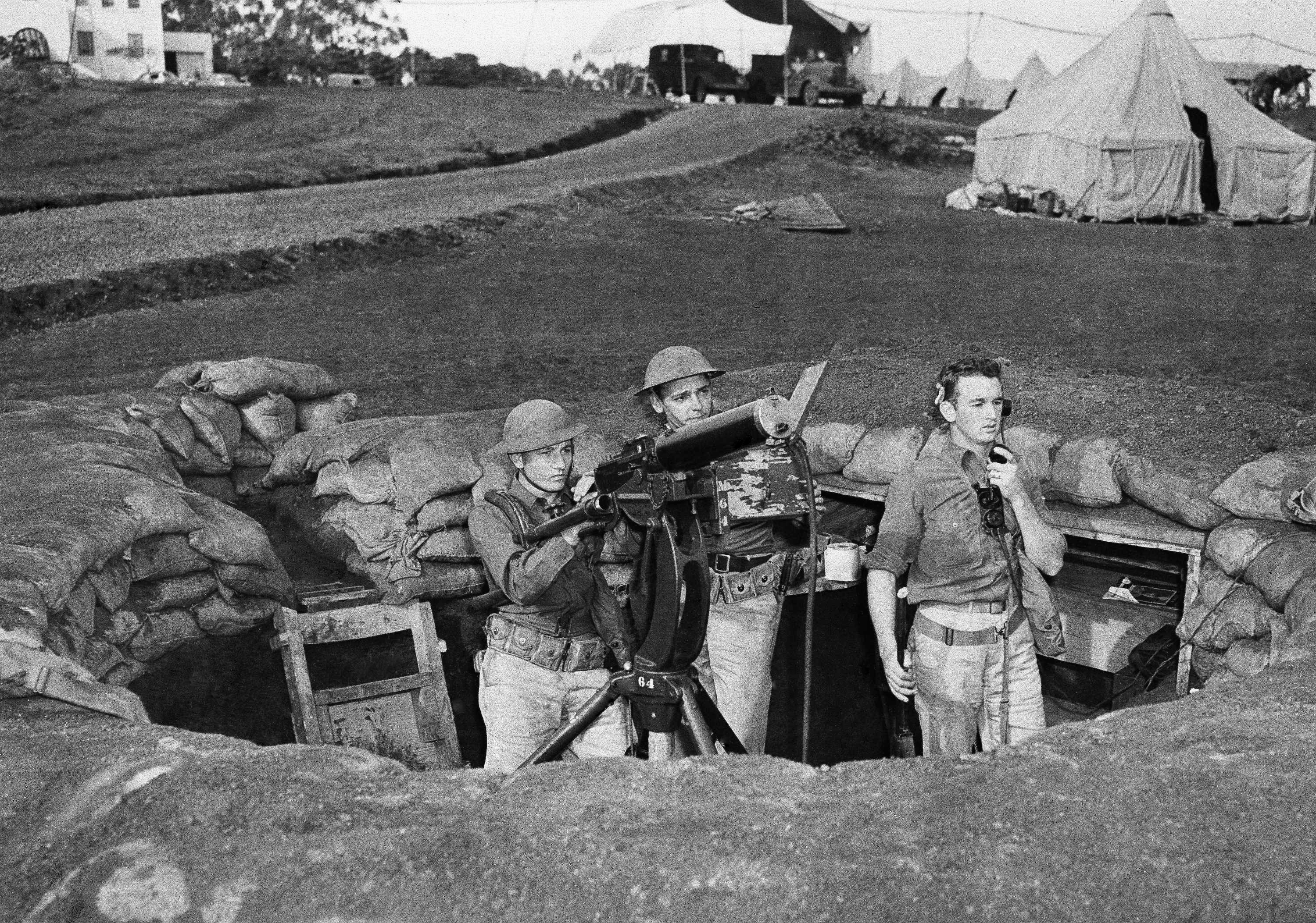 Troops man a machine gun nest at Wheeler Field, which adjoins Schofield Barracks in Honolulu, after the Japanese attack on the island of Oahu, Dec. 7, 1941. (AP Photo)