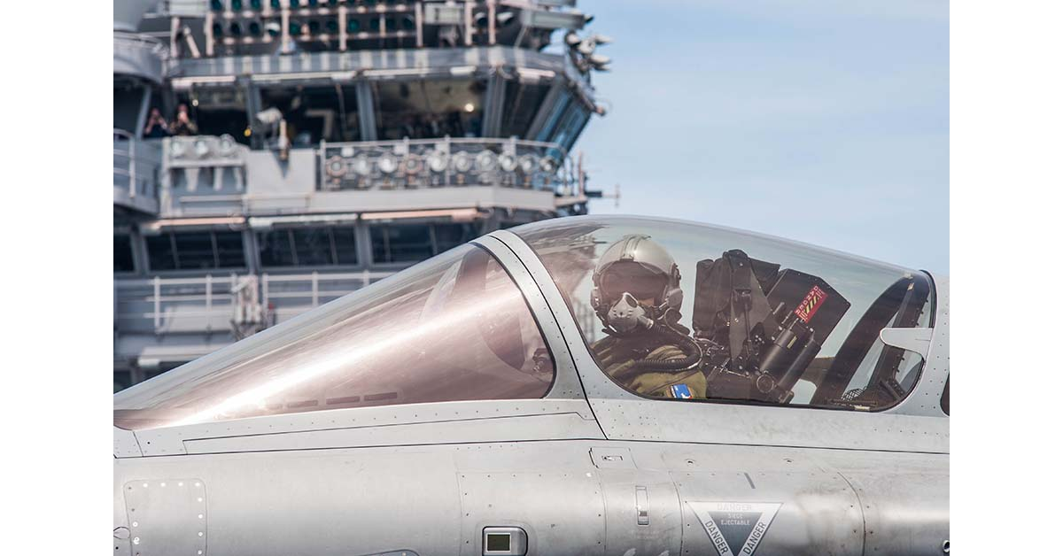 A French pilot in the cockpit of a Rafael Marine fighter aircraft taxi's to the Catapult 1 onboard the aircraft carrier George H. W. Bush on May 10, 2018, during joint US and French carrier flight operations May 10. (Mark D. Faram/Staff)