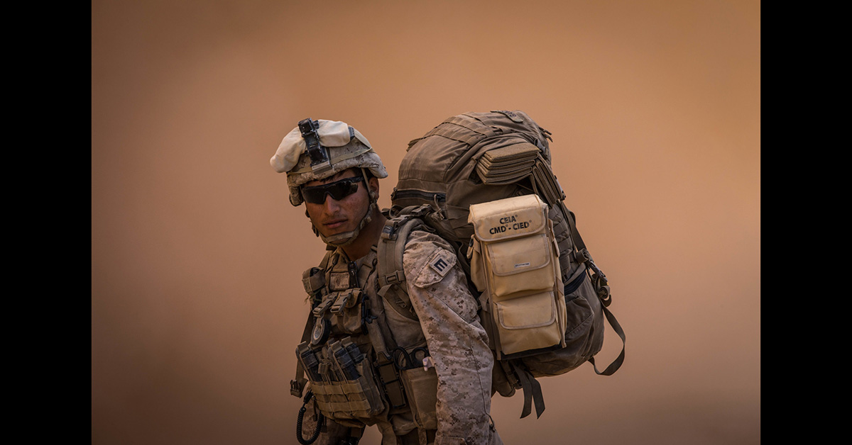 A Marine attached to Special Purpose Marine Air-Ground Task Force, Crisis Response-Central Command prepares to board an MV-22 Osprey at Fire Base Um Jorais (FB UJ) July 6, 2018. (Cpl. Carlos Lopez/Marine Corps)