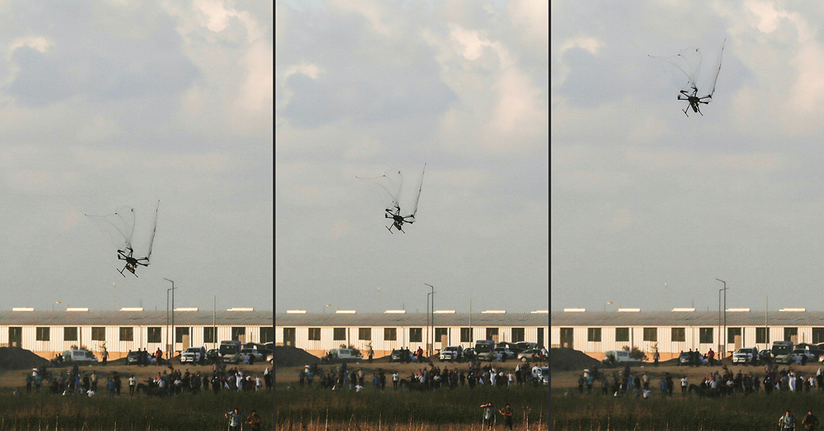 This combination of pictures taken and created on September 7, 2018 shows an Israeli army drone falling after being covered by a net thrown at it by Palestinian protester during clashes following a demonstration along the Israel-Gaza border, east of Gaza City in the central Gaza Strip. (SAID KHATIB/AFP/Getty Images)