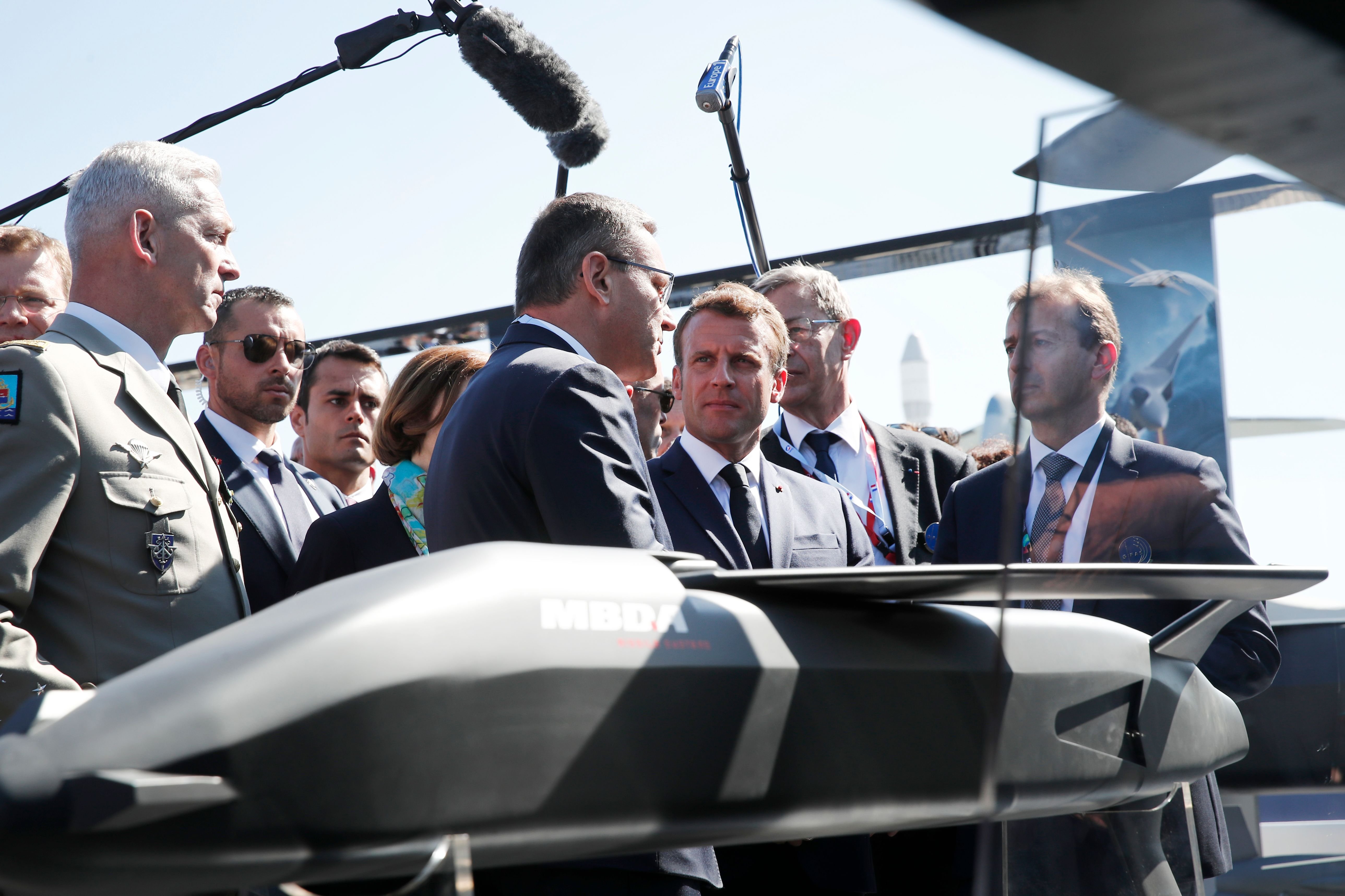 French President Emmanuel Macron (C) talks with Eric Beranger (C, left), chief executive officer of MBDA missile Systems, during a visit at the 53rd International Paris Air Show at Le Bourget Airport near Paris, on June 17, 2019. (Benoit Tessier/AFP/Getty Images)