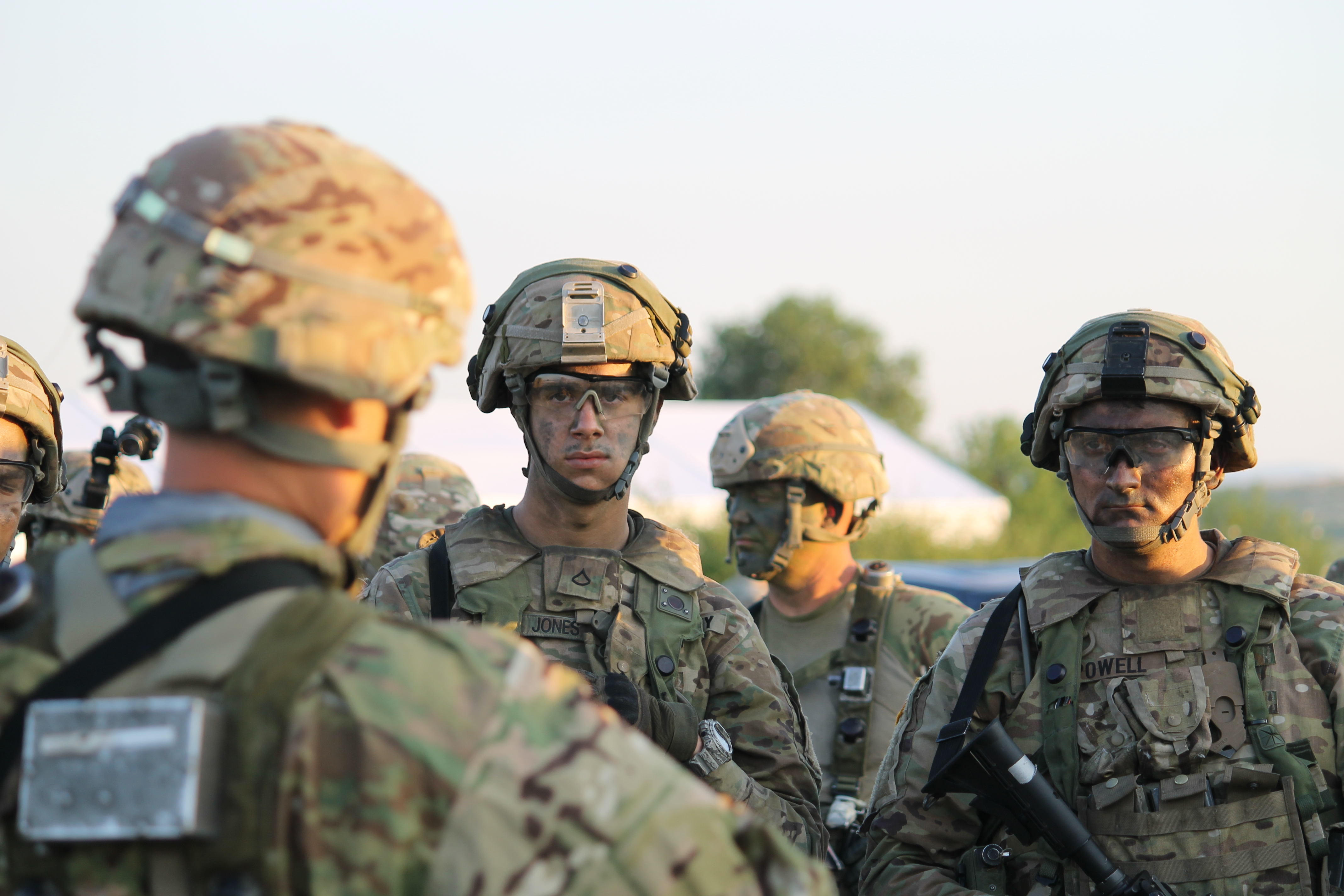 The U.S. Stryker unit listens to instructions before loading and heading over to the airfield. (Jen Judson/Staff)