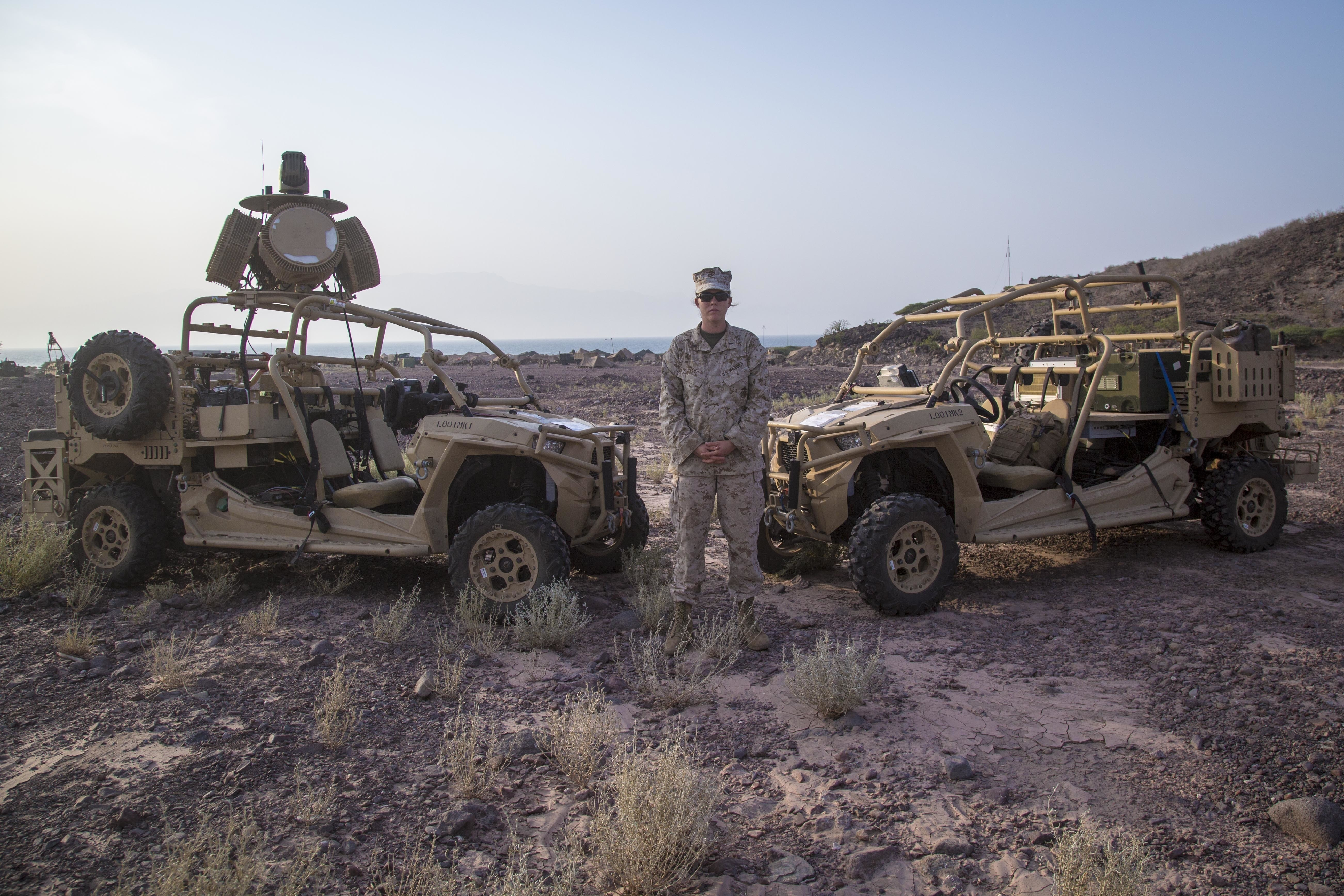 Marine 1st Lt. Ariel Cecil poses in front of the Light Marine Air Defense Integrated System during Theater Amphibious Combat Rehearsal 18. (Cpl. Francisco J. Diaz Jr./Marine Corps)