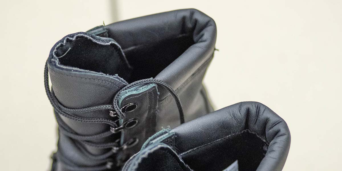 The Navy's new improved safety boot has a padded collar and an internal, moisture-wicking liner (Mark D. Faram/staff)