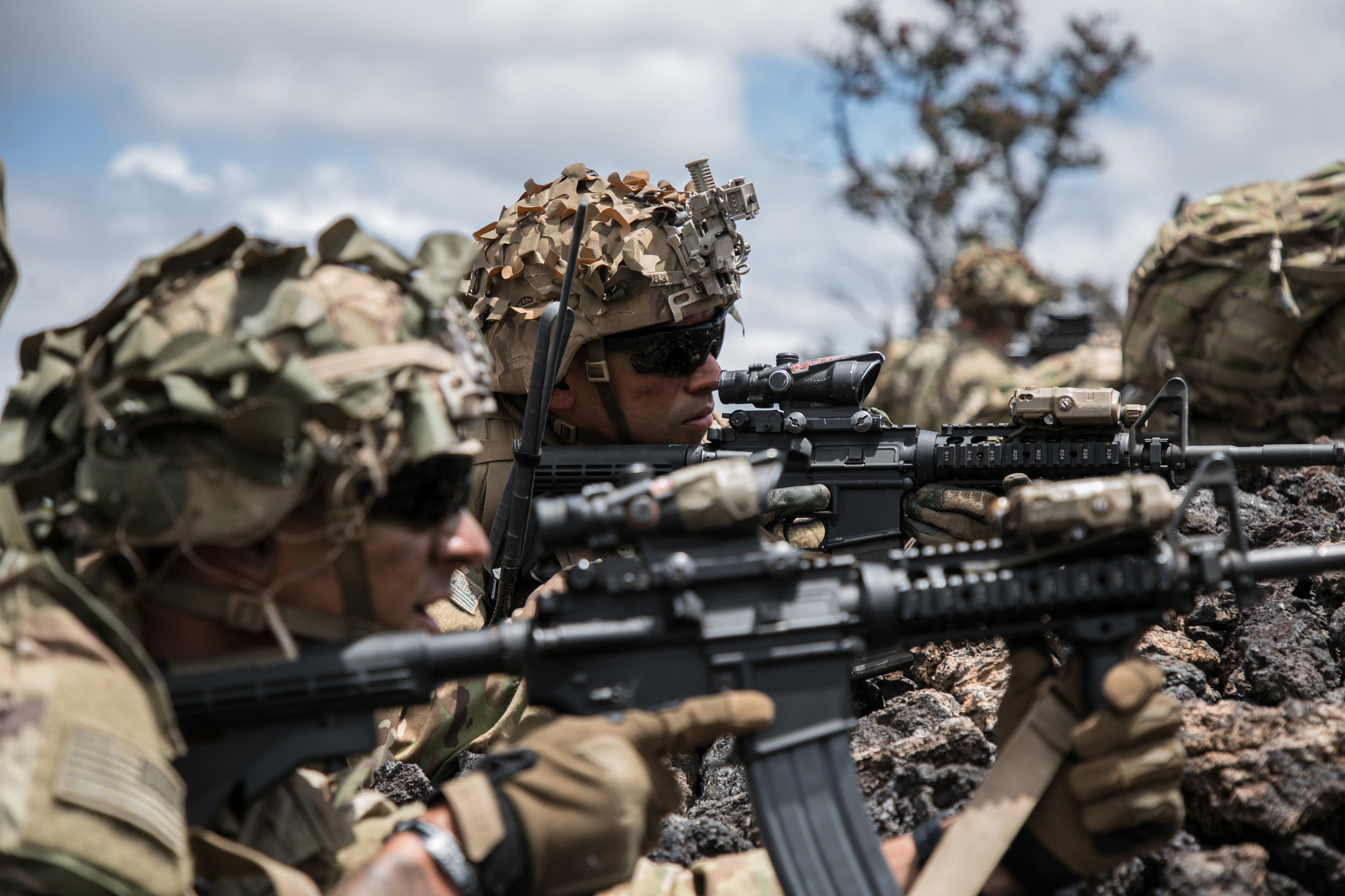Troopers assigned to 2nd Squadron, 14th Calvary Regiment, 2nd Infantry Brigade Combat Team, 25th Infantry Division provide security during a combined arms live-fire exercise at Pohakuloa Training Area, Hawaii, May 15, 2018. (1st Lt. Ryan DeBooy/Army)