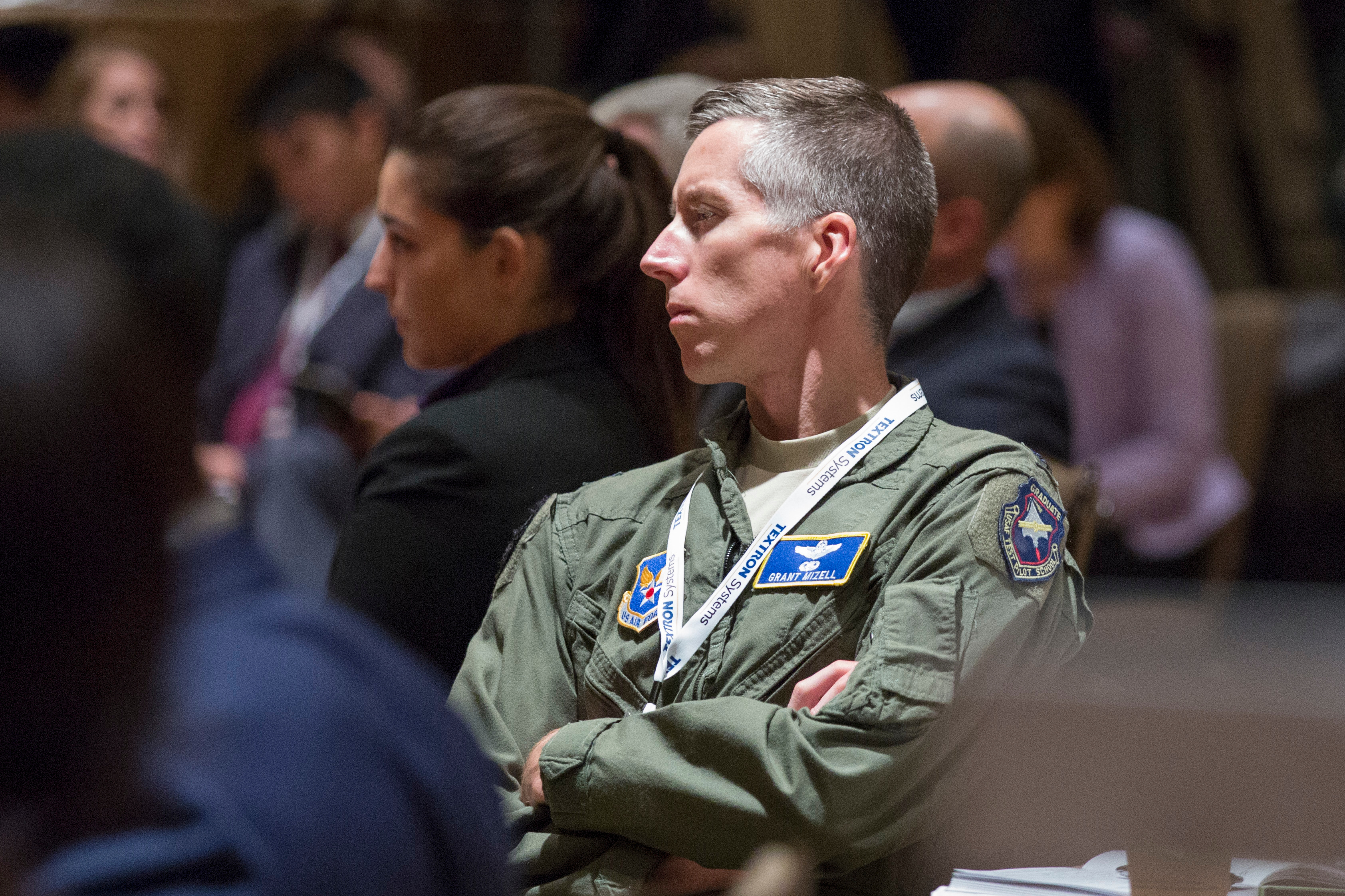 An attendee of the Defense News Conference listens to a panel on unmanned platforms on Sept. 6, 2017. (Amber Corrin/Staff)