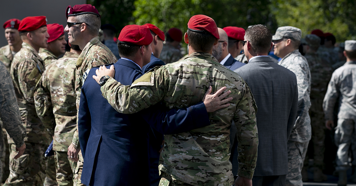 Airmen hug after a Medal of Honor unveiling ceremony at the Air Force Memorial for Air Force combat controller Technical Sgt. John Chapman, who was awarded the MOH on Wednesday. (Alan Lessig/Staff)