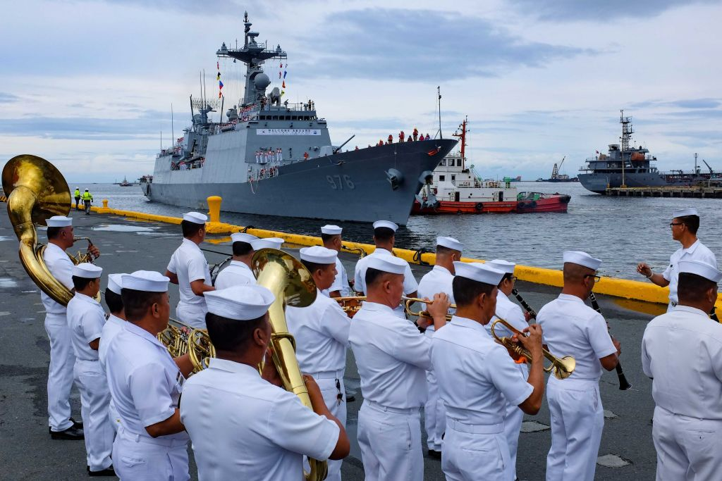 The Philippine Navy band performs during a welcome ceremony for South Korean navy destroyer ROKS Munmu the Great (DDH-976) as it docks at the port of Manila on September 2, 2019. - The ship, named after the 30th King of the Silla Dynasty who unified the Korean peninsula in 676 AD, is in port as part of a three-day goodwill visit to the Philippines. (GEORGE CALVELO/AFP/Getty Images)