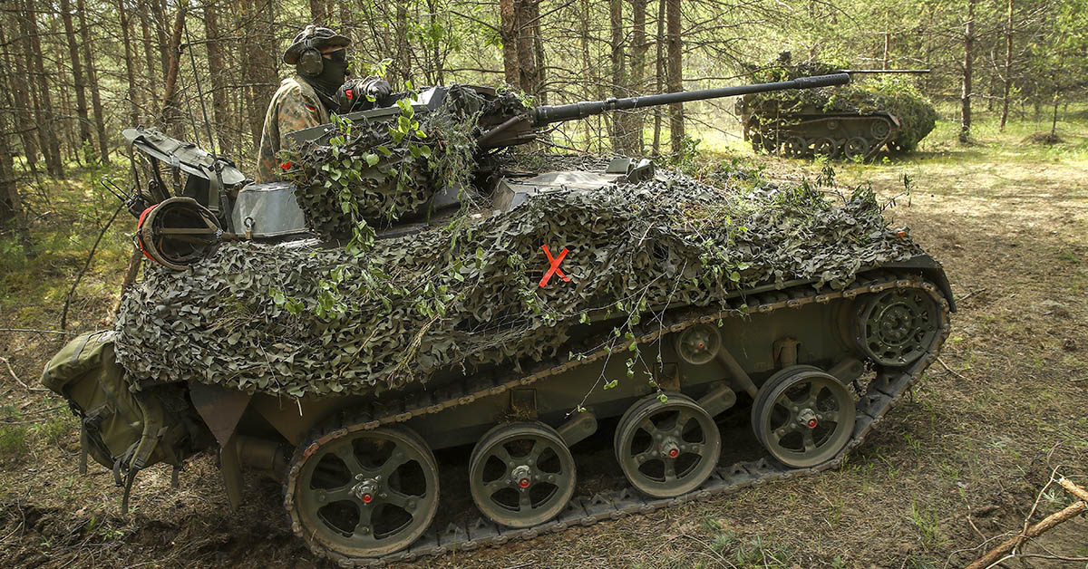 Two Wiesel armored fighting vehicles of the German armed forces maneuver through a forest during Thunder Storm 2018, a multinational NATO military exercise, on June 7, 2018, near Pabrade, Lithuania. (Sean Gallup/Getty Images)